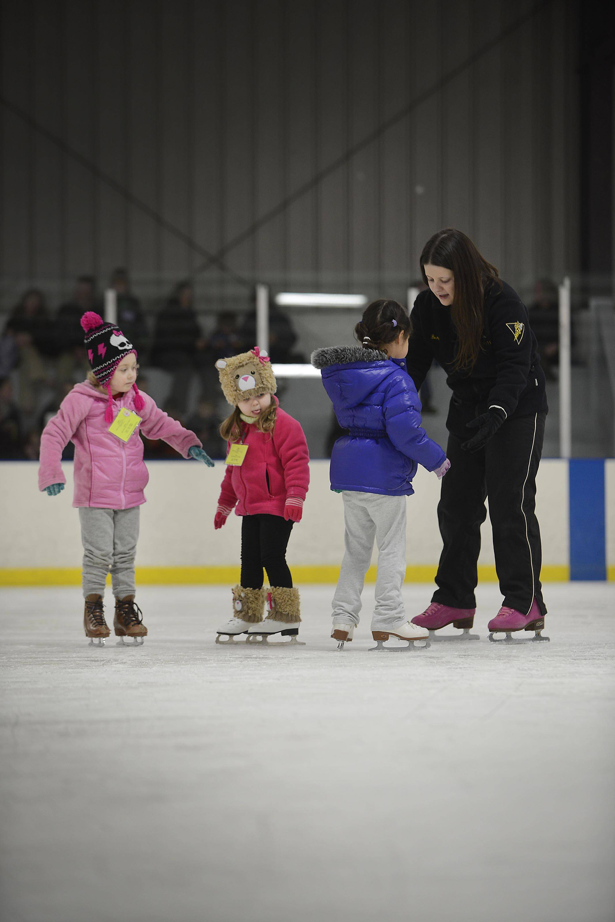 Instructor Becky Spillar works with 4-5 year olds in the Snowplow Sam beginers skating class at Crystal Ice House Thursday in Crystal Lake. Some children start even younger.