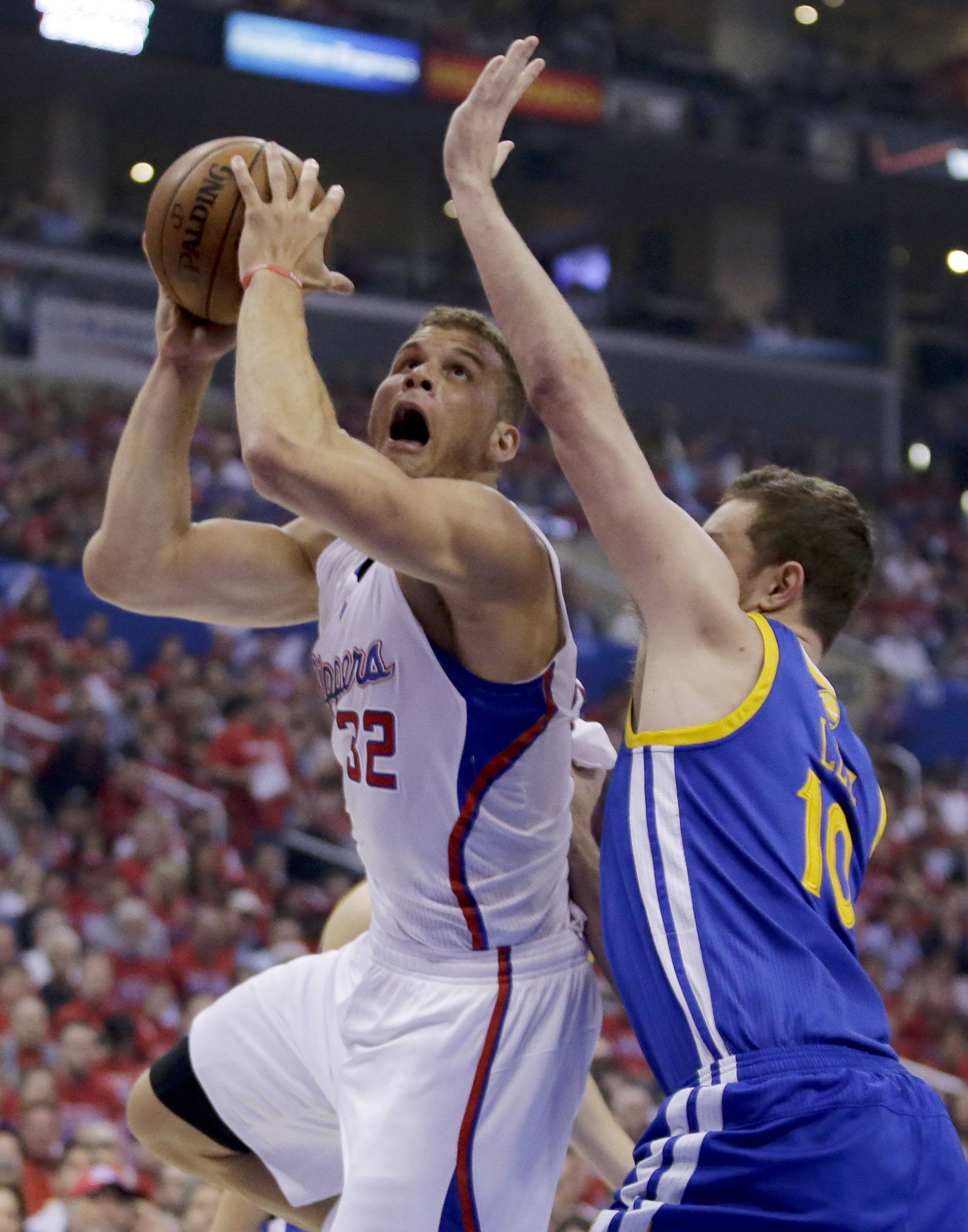 Los Angeles Clippers forward Blake Griffin, left, shoots around Golden State Warriors forward David Lee during the first half in Game 2 of an opening-round NBA basketball playoff series in Los Angeles, Monday, April 21, 2014.