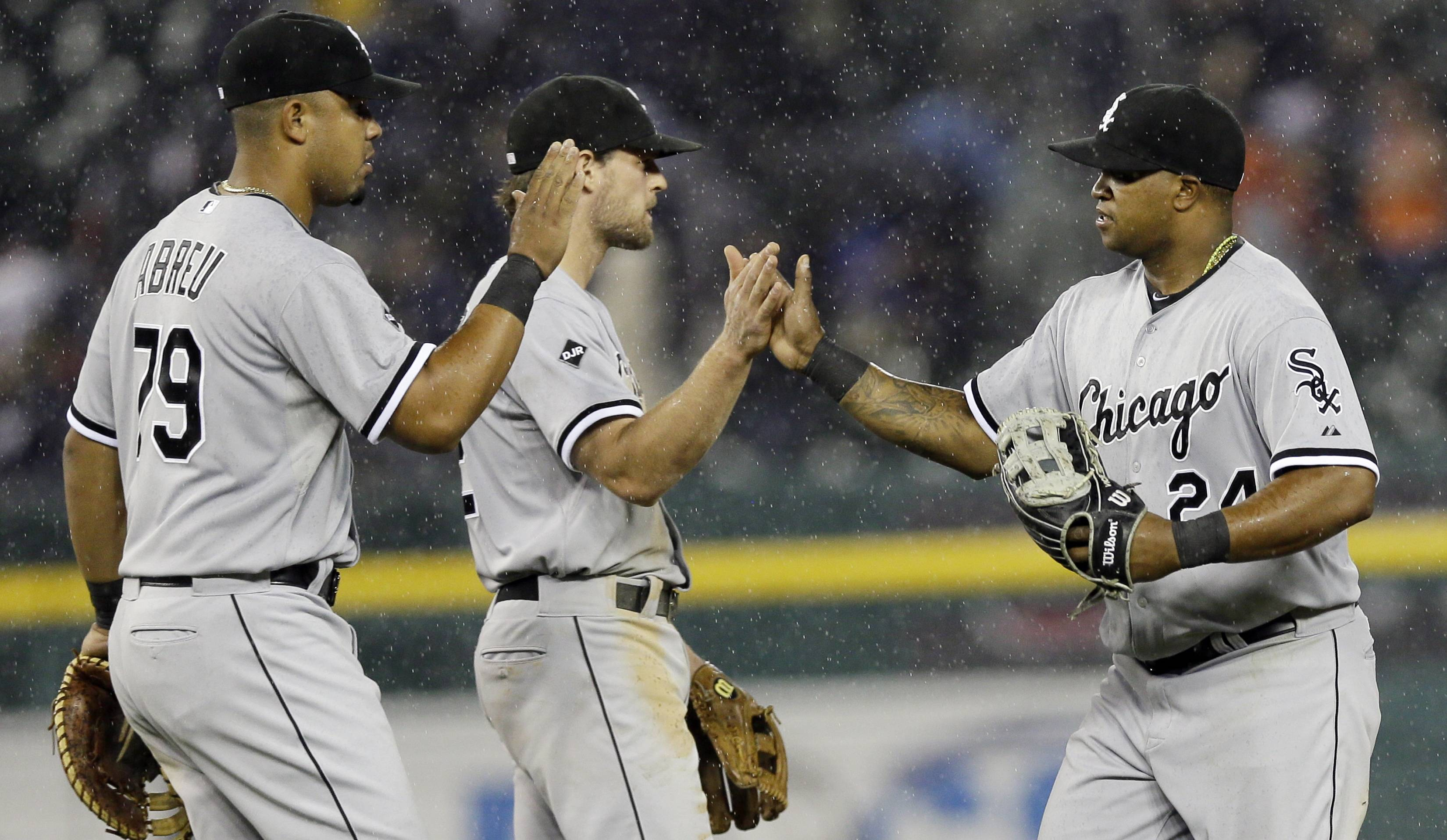 White Sox right fielder Dayan Viciedo, right, high-fives teammates Jose Abreu and Conor Gillaspie after their 3-1 win Monday over the Detroit Tigers.