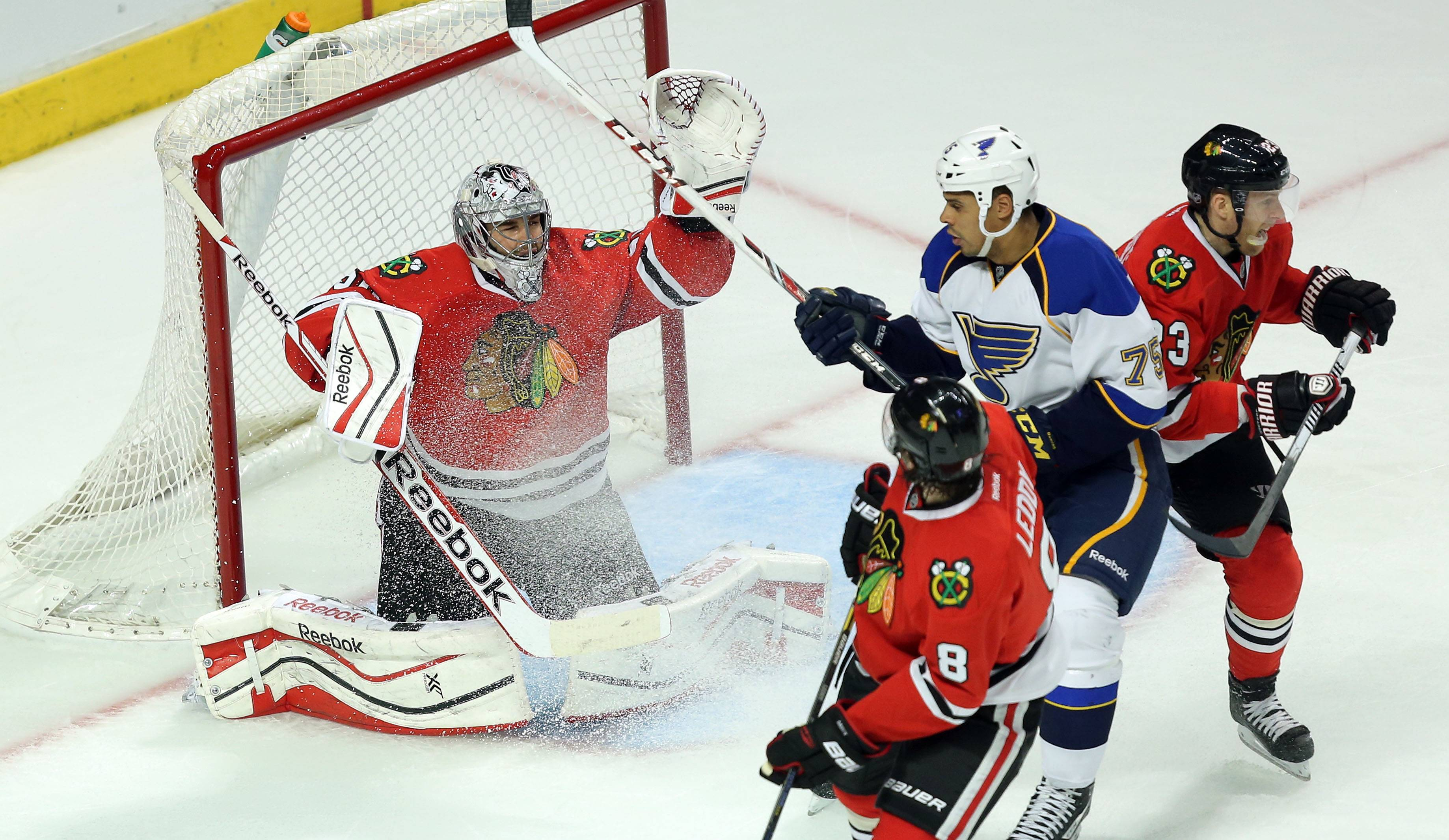 Chicago Blackhawks goalie Corey Crawford deflects the puck.