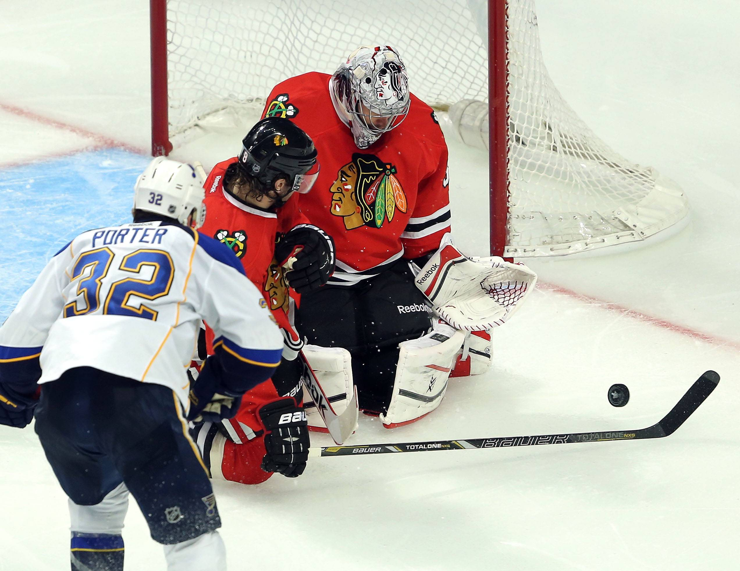 Chicago Blackhawks goalie Corey Crawford makes a save on St. Louis Blues left wing Chris Porter's shot on goal.