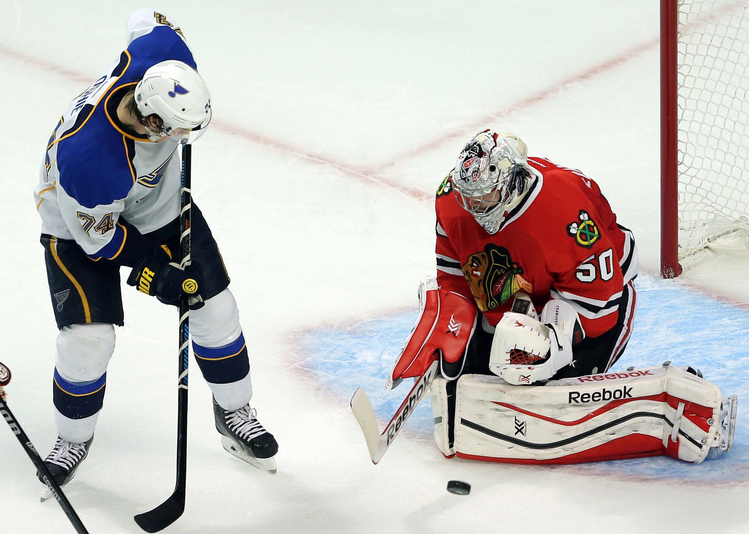 St. Louis Blues right wing T.J. Oshie shoots on Chicago Blackhawks goalie Corey Crawford.