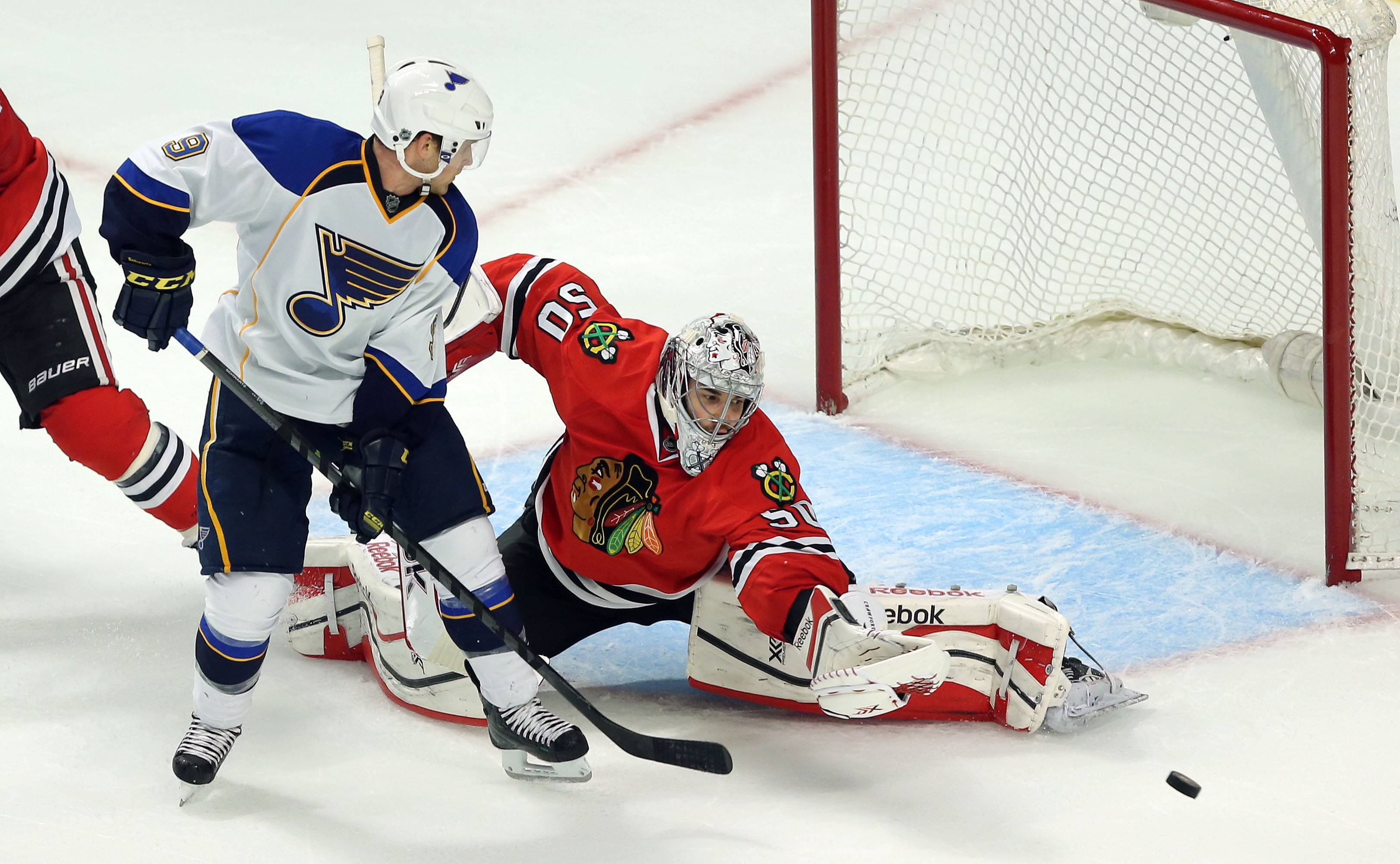 Chicago Blackhawks goalie Corey Crawford makes a save on St. Louis Blues left wing Jaden Schwartz.