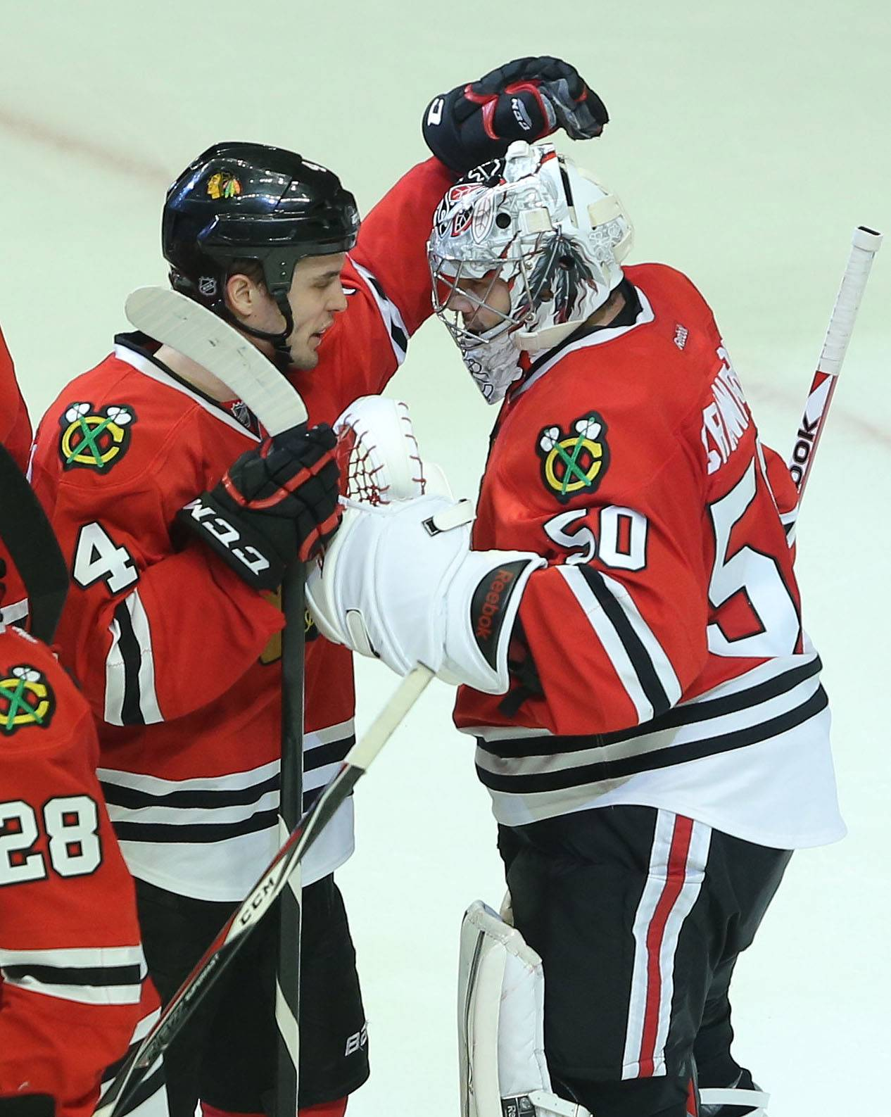 Chicago Blackhawks defenseman Niklas Hjalmarsson congratulates Chicago Blackhawks goalie Corey Crawford after the 2-0 win.
