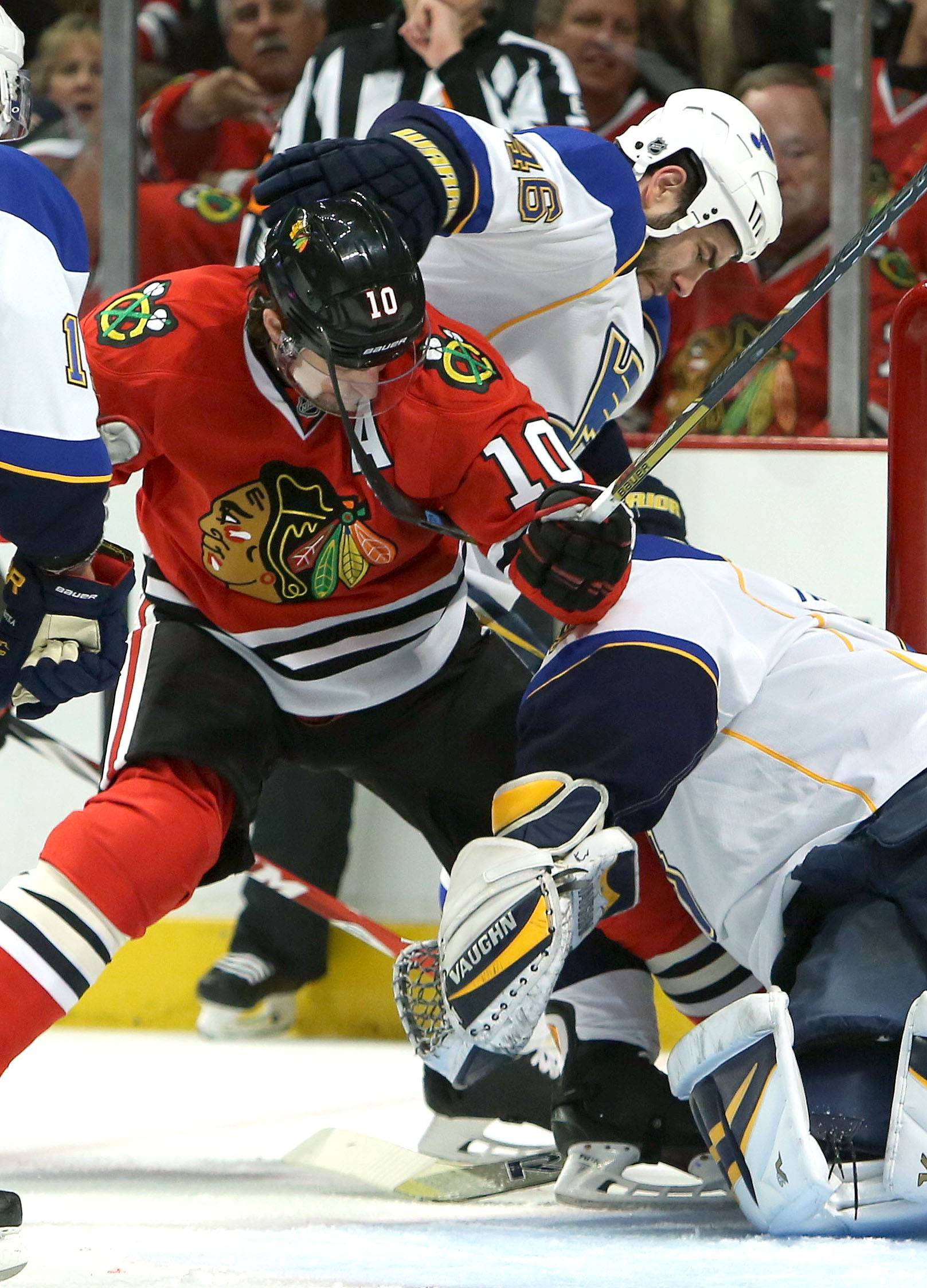 St. Louis Blues center Steve Ott and Chicago Blackhawks right wing Ben Smith battle .