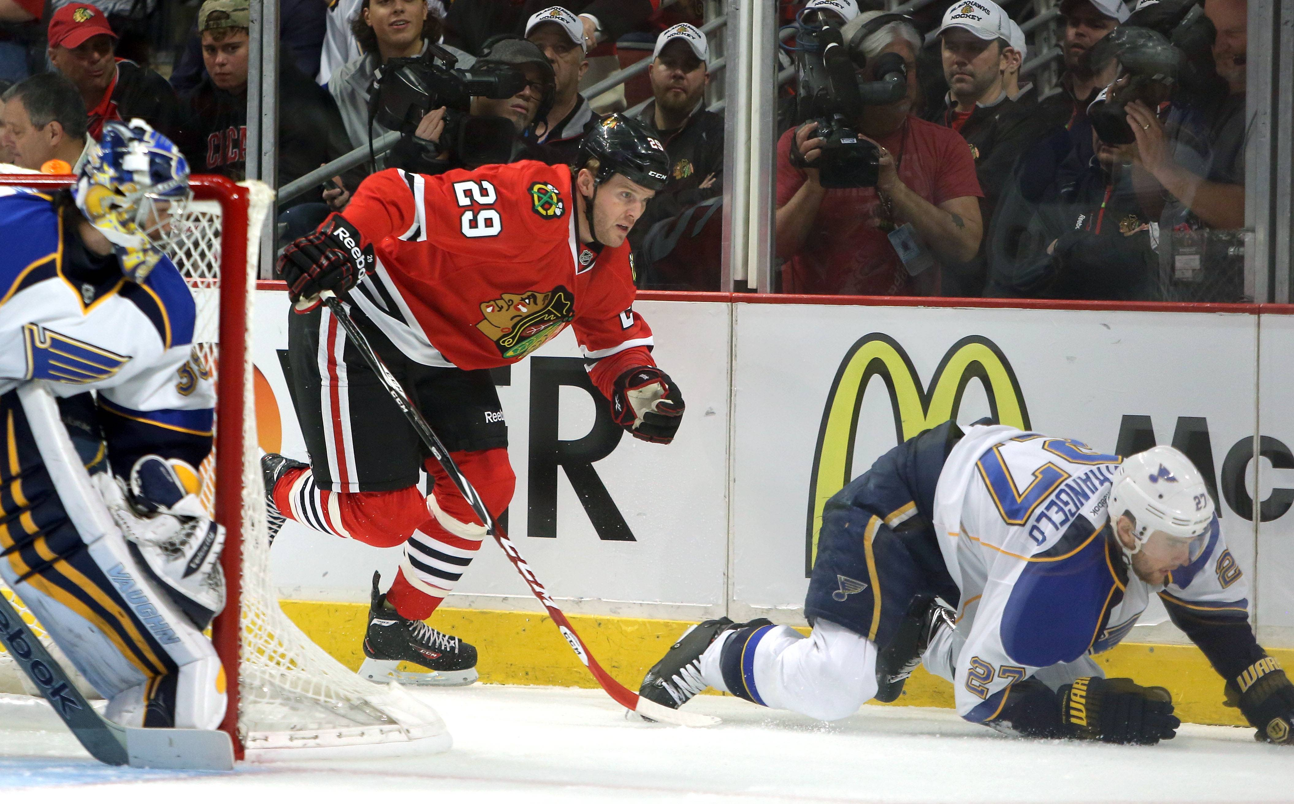 Chicago Blackhawks left wing Bryan Bickell chases down St. Louis Blues defenseman Alex Pietrangelo.