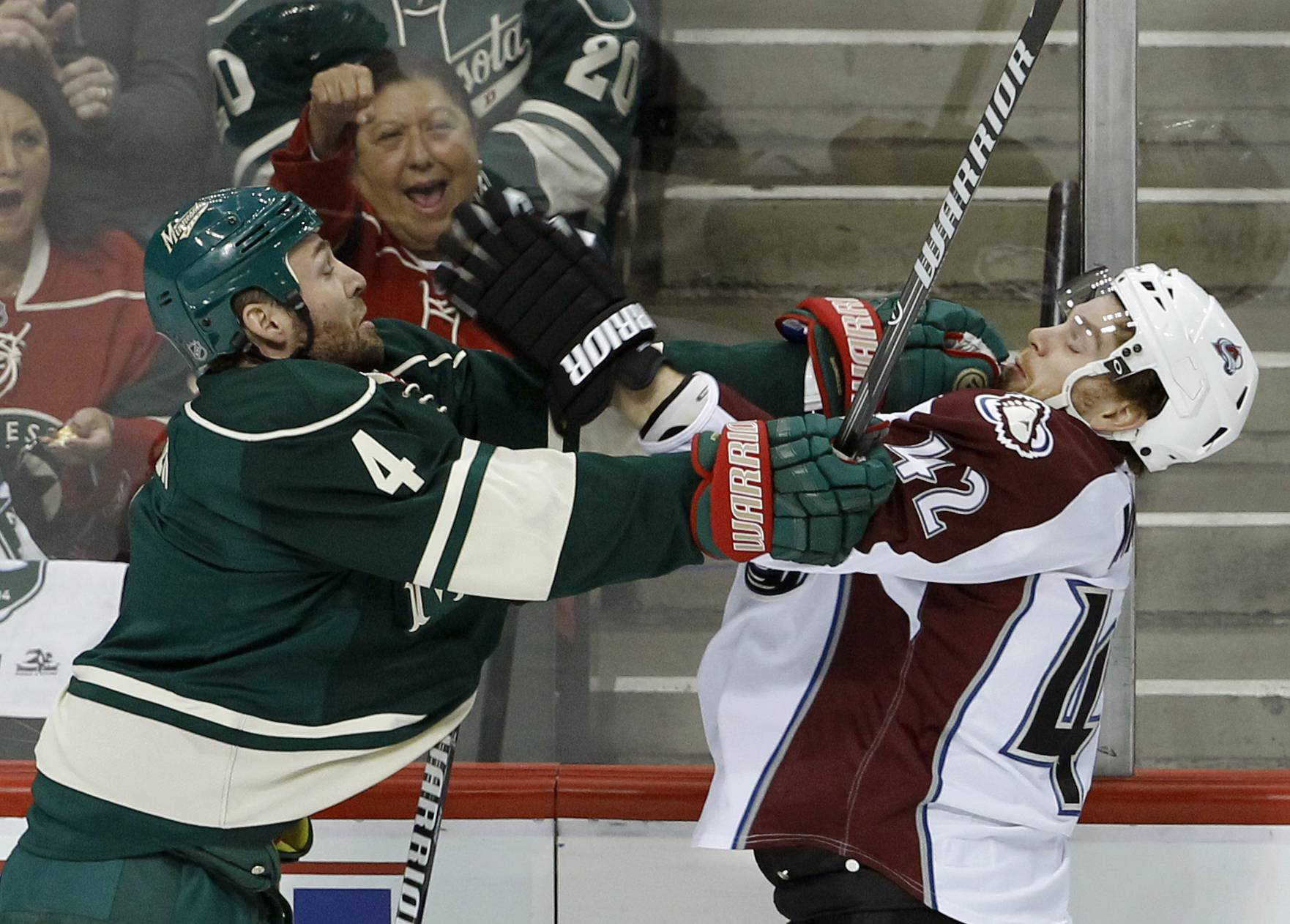 Minnesota Wild defenseman Clayton Stoner (4) shoves Colorado Avalanche center Brad Malone (42) during the first period of Game 3 of an NHL hockey first-round playoff series in St. Paul, Minn., Monday, April 21, 2014.
