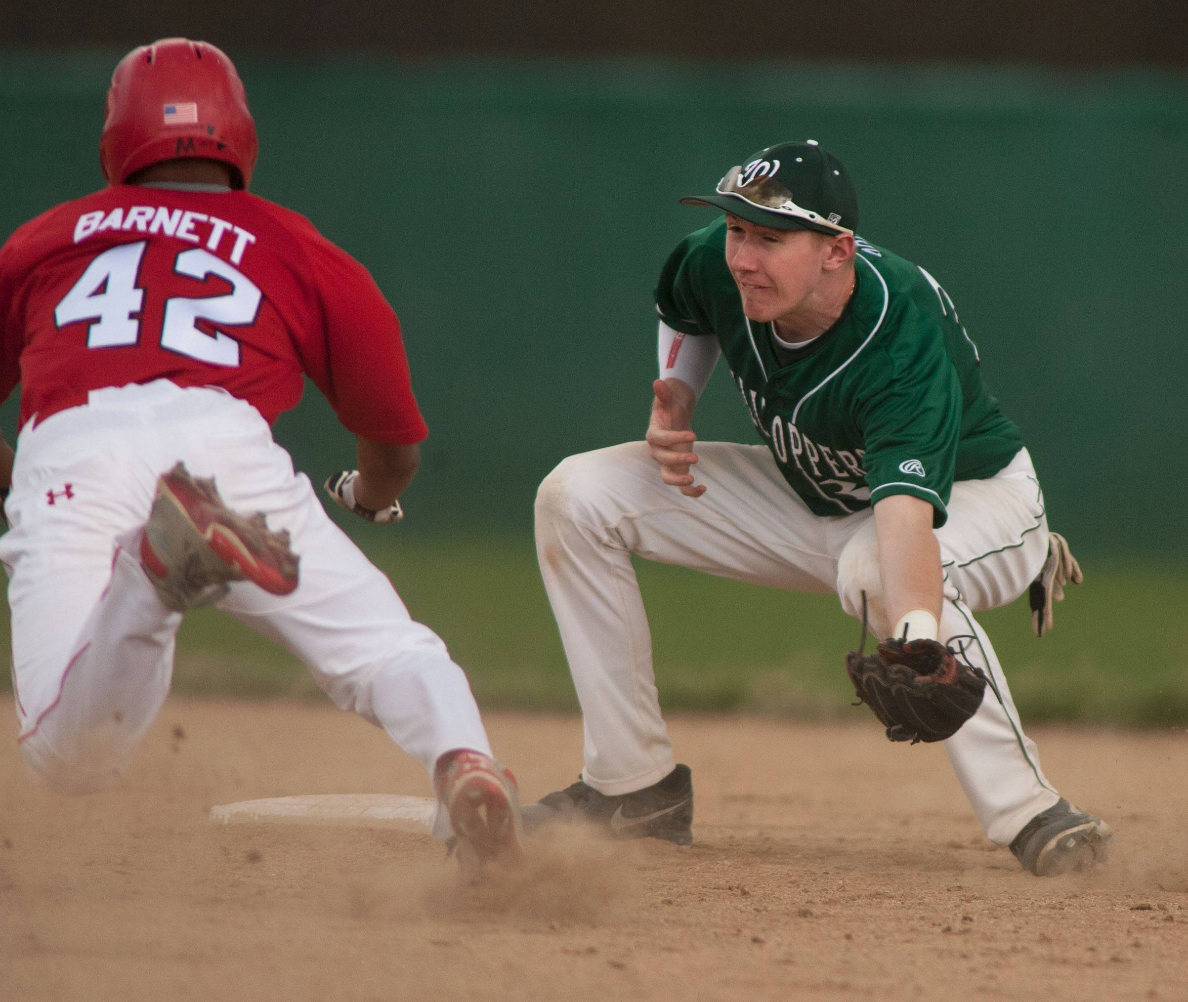 Glenbard West's Billy Becker tags out Hinsdale Central's Trenton Barnett, during a loss to the Red Devils.