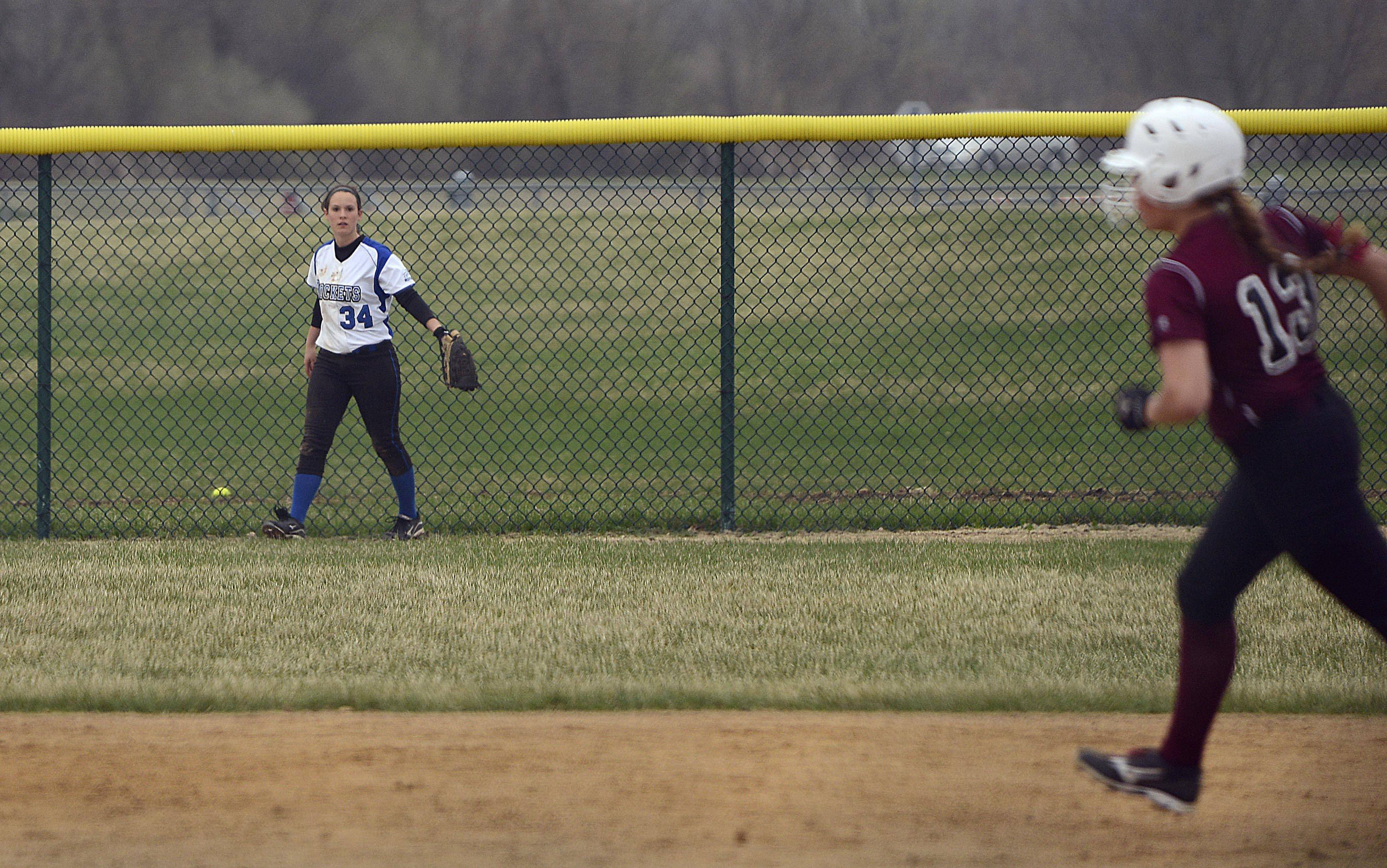 Burlington Central's Shelby Young turns away from the home run ball behind the fence to watch Marengo's Taylor Carlson round the bases with the go-ahead 2-run shot in the sixth inning Monday in Marengo.