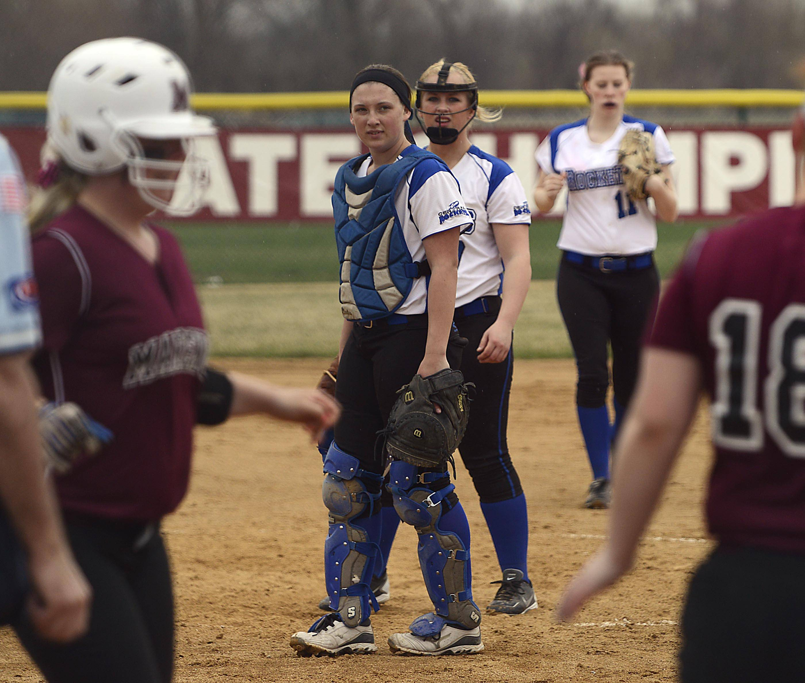 Burlington Central catcher Bekah Harnish and pitcher Brooke Gaylord watch as Marengo's Abby Kissack approaches the plate after her game-tying home run in the sixth inning Monday in Marengo.