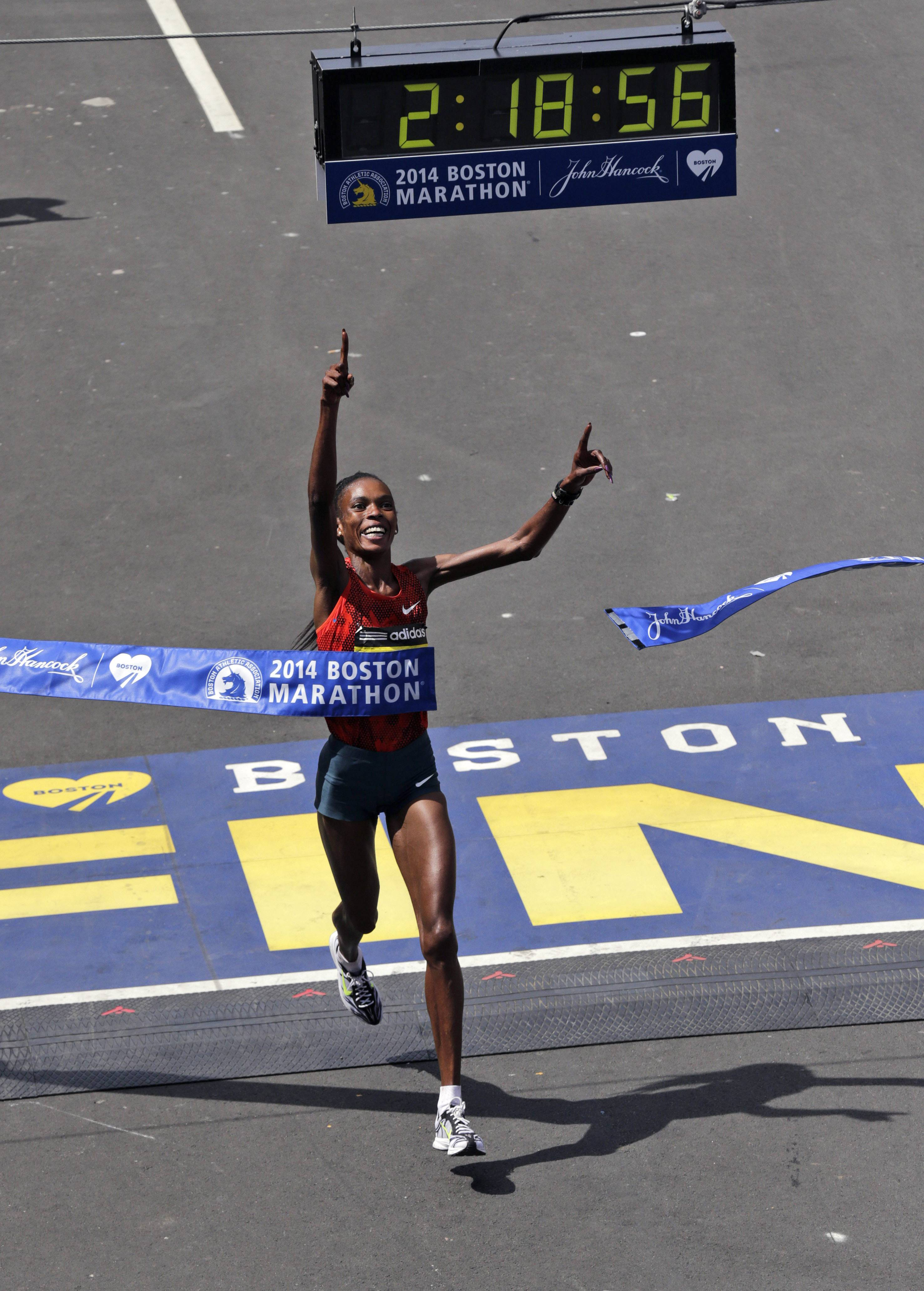 Rita Jeptoo, of Kenya, breaks the tape to win the women's division of the 118th Boston Marathon Monday, April 21, 2014 in Boston.