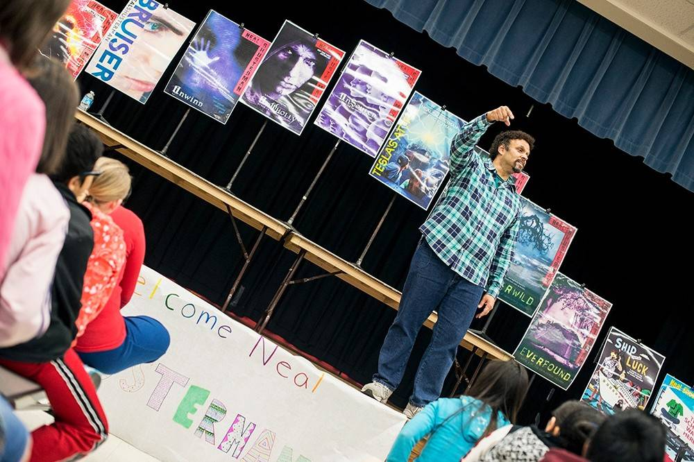 Neal Shusterman participates in a question and answer assembly with students at Grove Junior High School in Elk Grove Village.