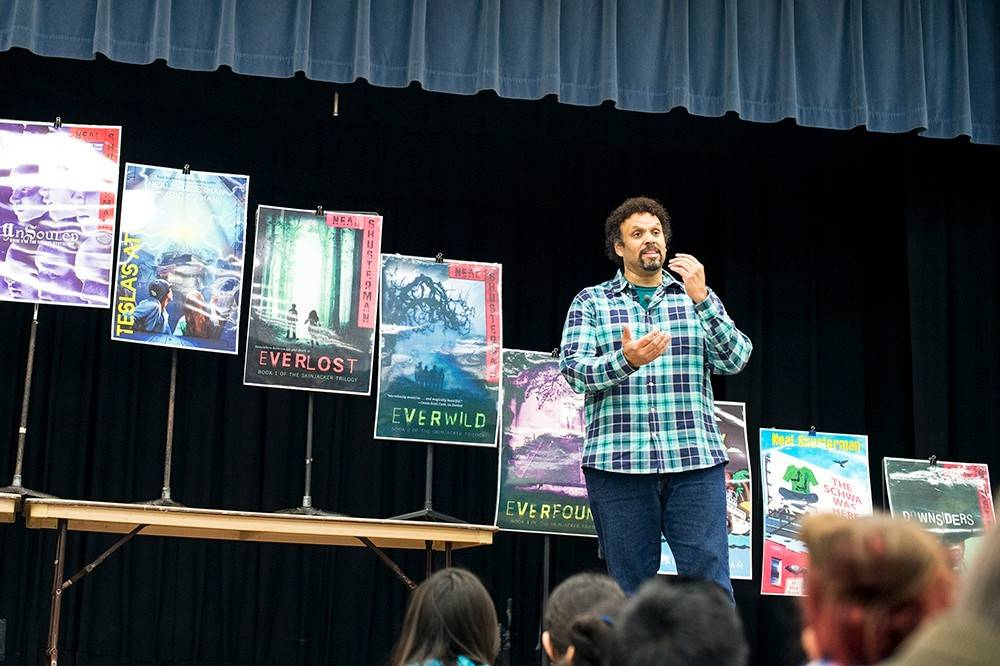Neal Shusterman talks with students at Grove Junior High School in Elk Grove Village. Shusterman spent a day at Grove fielding questions, conducting writing workshops and having lunch with students.