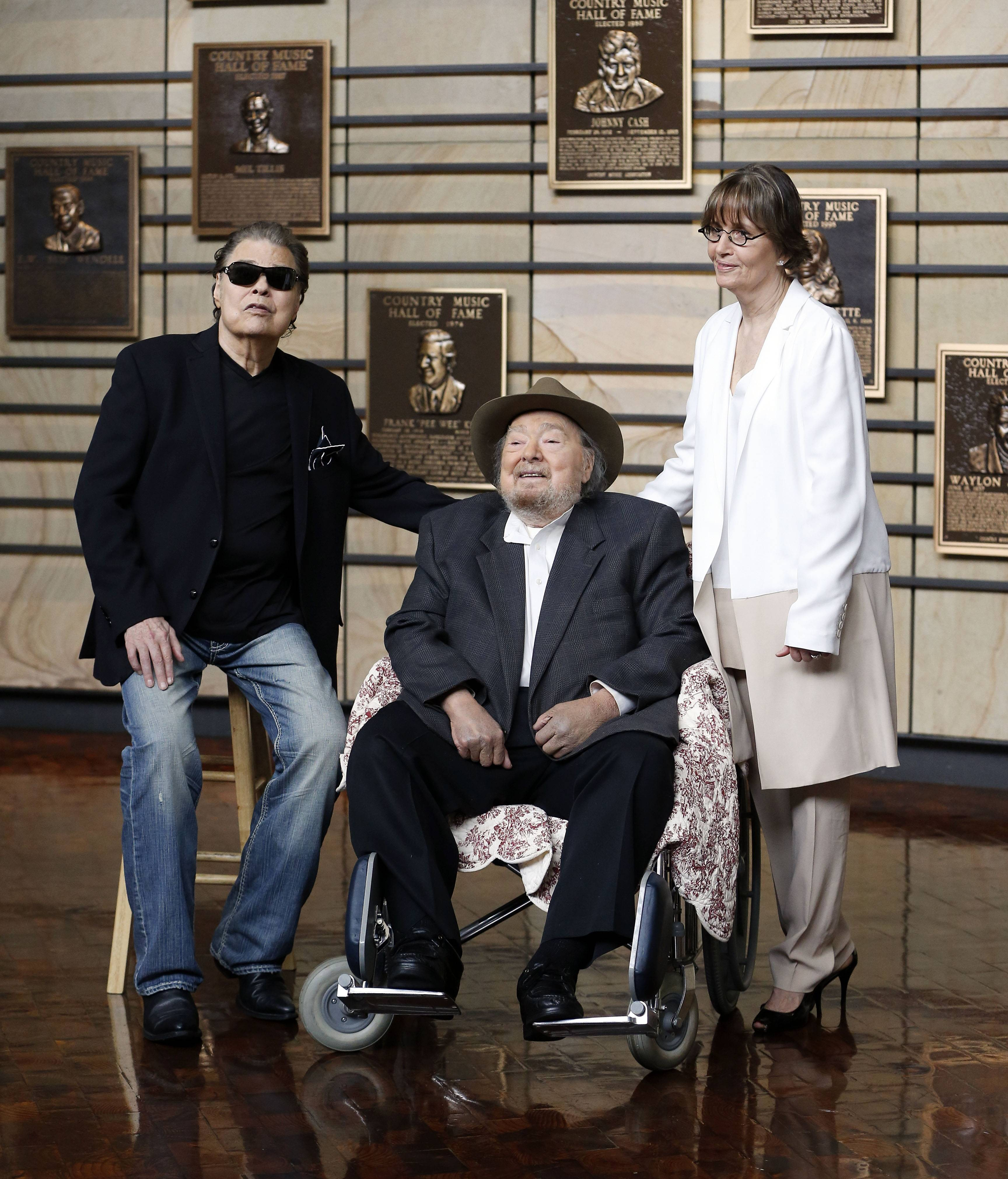 Ronnie Milsap, left, Mac Wiseman and Suzi Cochran, representing her late songwriter husband, Hank Cochran, were introduced as the new inductees into the Country Music Hall of Fame Tuesday in Nashville, Tenn.