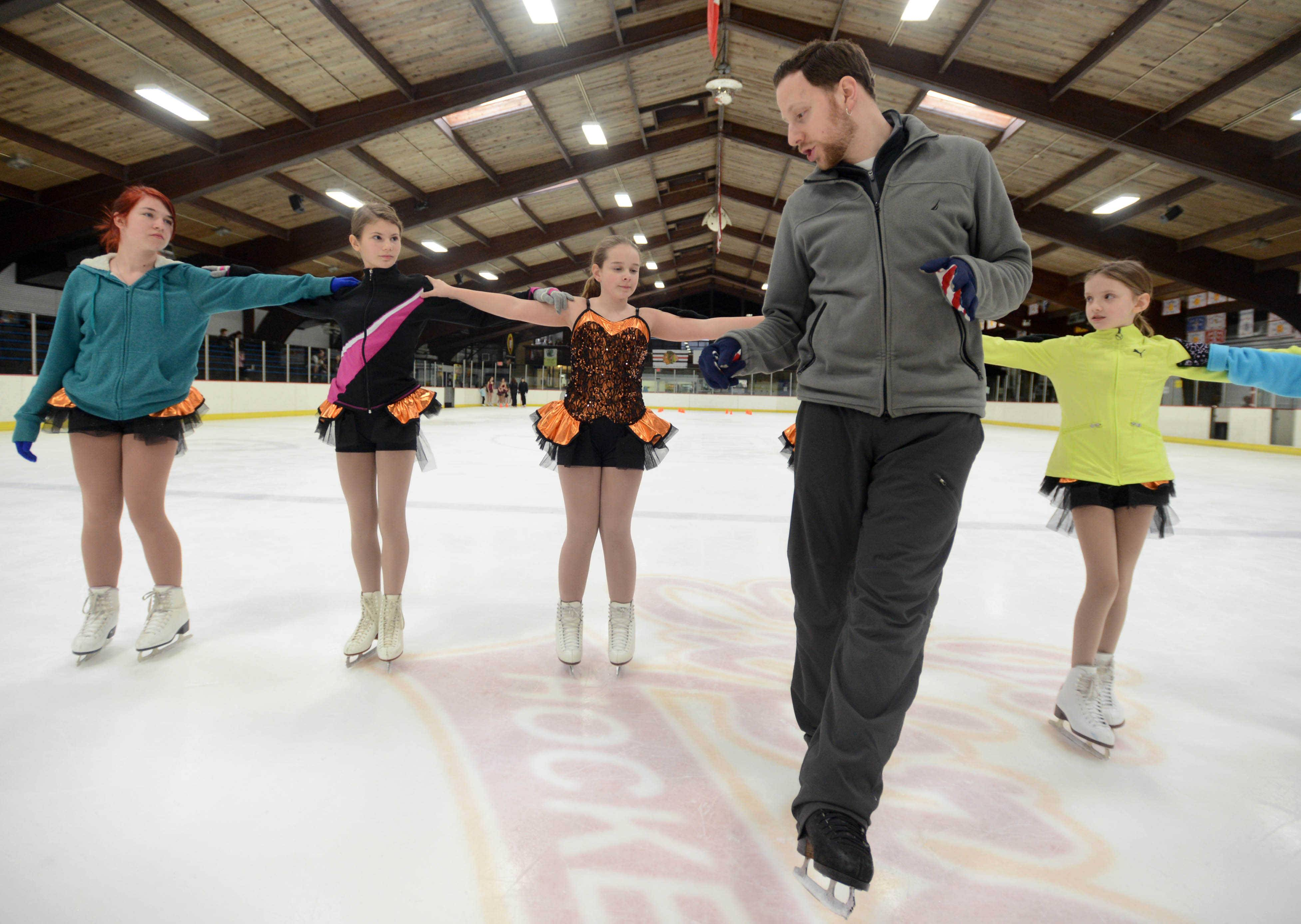 Coach Josh Fischel works with Gamma-level students during rehearsal at the Oakton Ice Arena for the upcoming Park Ridge Park District Ice Show.