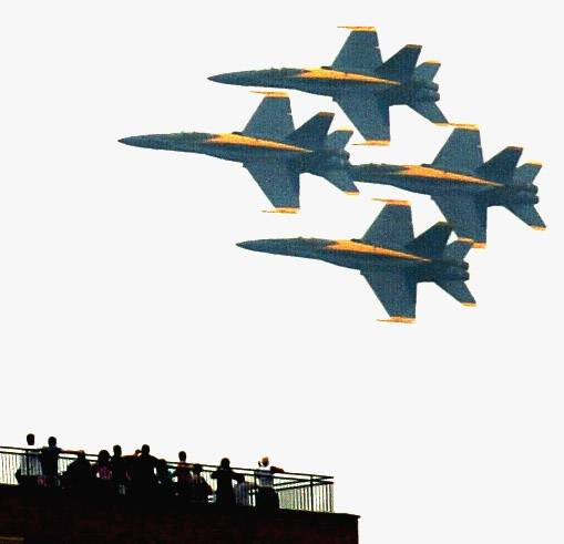 Spectators watch from a rooftop while the Blue Angels fly by during the Chicago Air and Water Show.