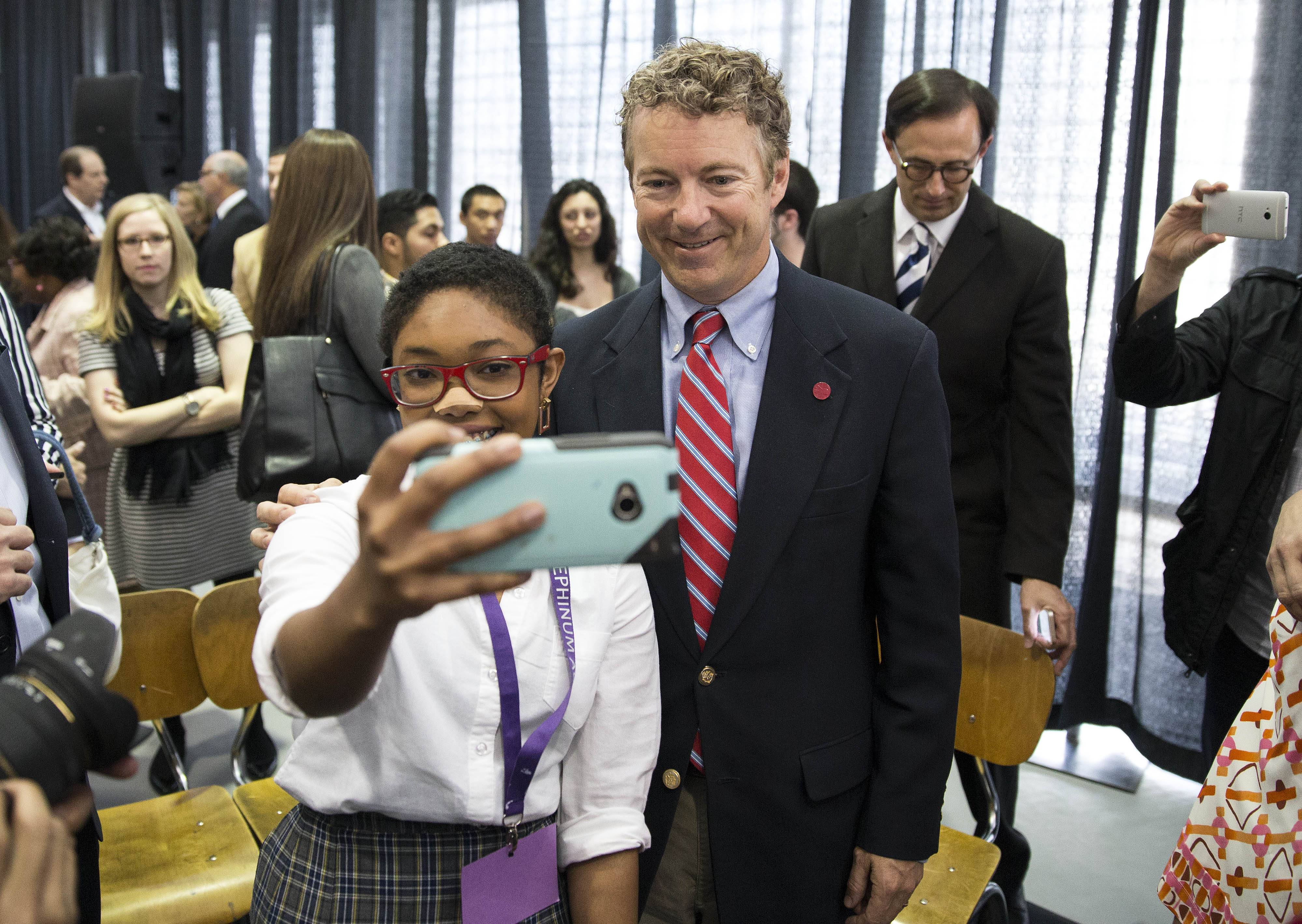 Angelika Noel, 17, poses with Sen. Rand Paul, a Kentucky Republican, during his visit to Josephinum Academy in Chicago to participate in a discussion on school choice on Tuesday.