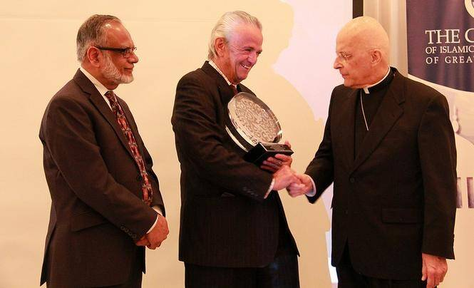Joe Burlini, center, with Cardinal George on the right and Mohammed Kaiseruddin, chairman of the Council of Islamic Organizations of Greater Chicago, on left.