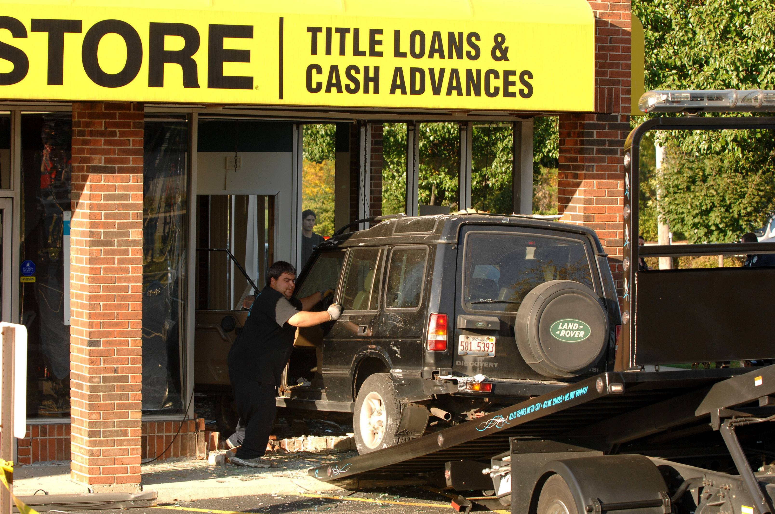 An SUV crashed into the Cash Store on Oct. 4, 2001, at the intersection of Stewart Ave and Roosevelt Road in Lombard. The car was heading west bound on Roosevelt Road at some point veered off the road driving over a small tree then over a sidewalk, through a small parking lot before coming to rest inside the Cash Store.