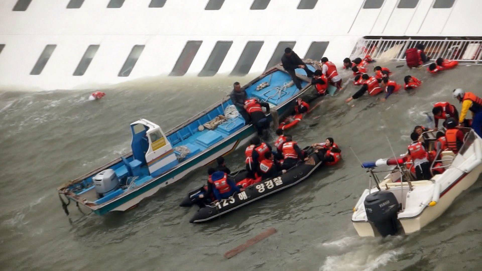 Passengers from the Sewol, a South Korean ferry sinking off South Korea's southern coast, are rescued by South Korean Coast Guard personnel in the water off the southern coast near Jindo, south of Seoul.