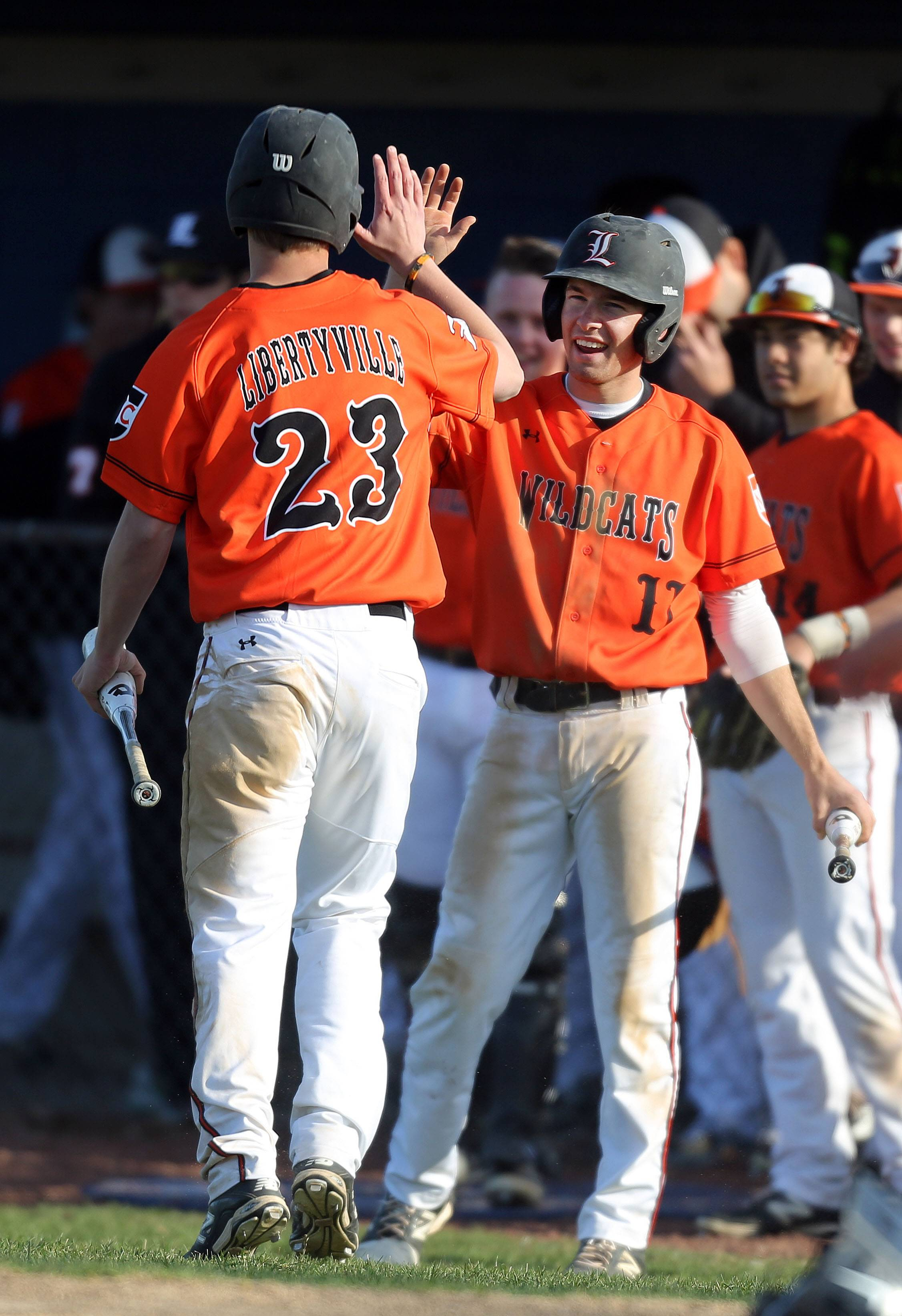 Libertyville's Ben Manski, left, get a high five from Jimmy Govern after scoring Tuesday at Lake Zurich.