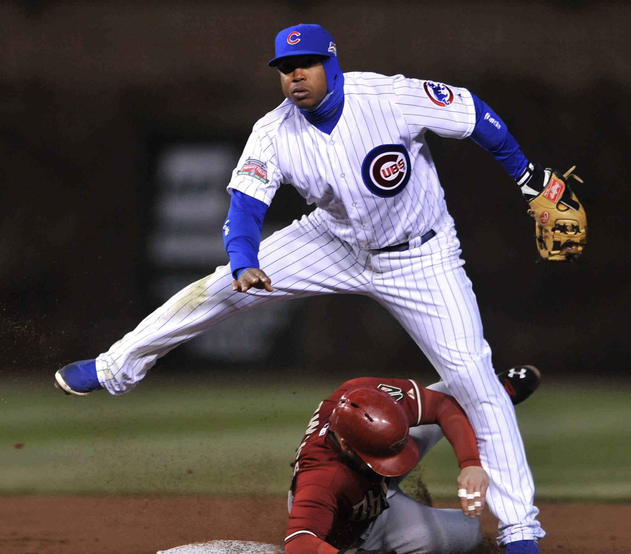 Cubs second baseman Luis Valbuena watches his throw to first base after forcing out the Diamondbacks' Chris Owings at second in the third inning Tuesday at Wrigley Field.