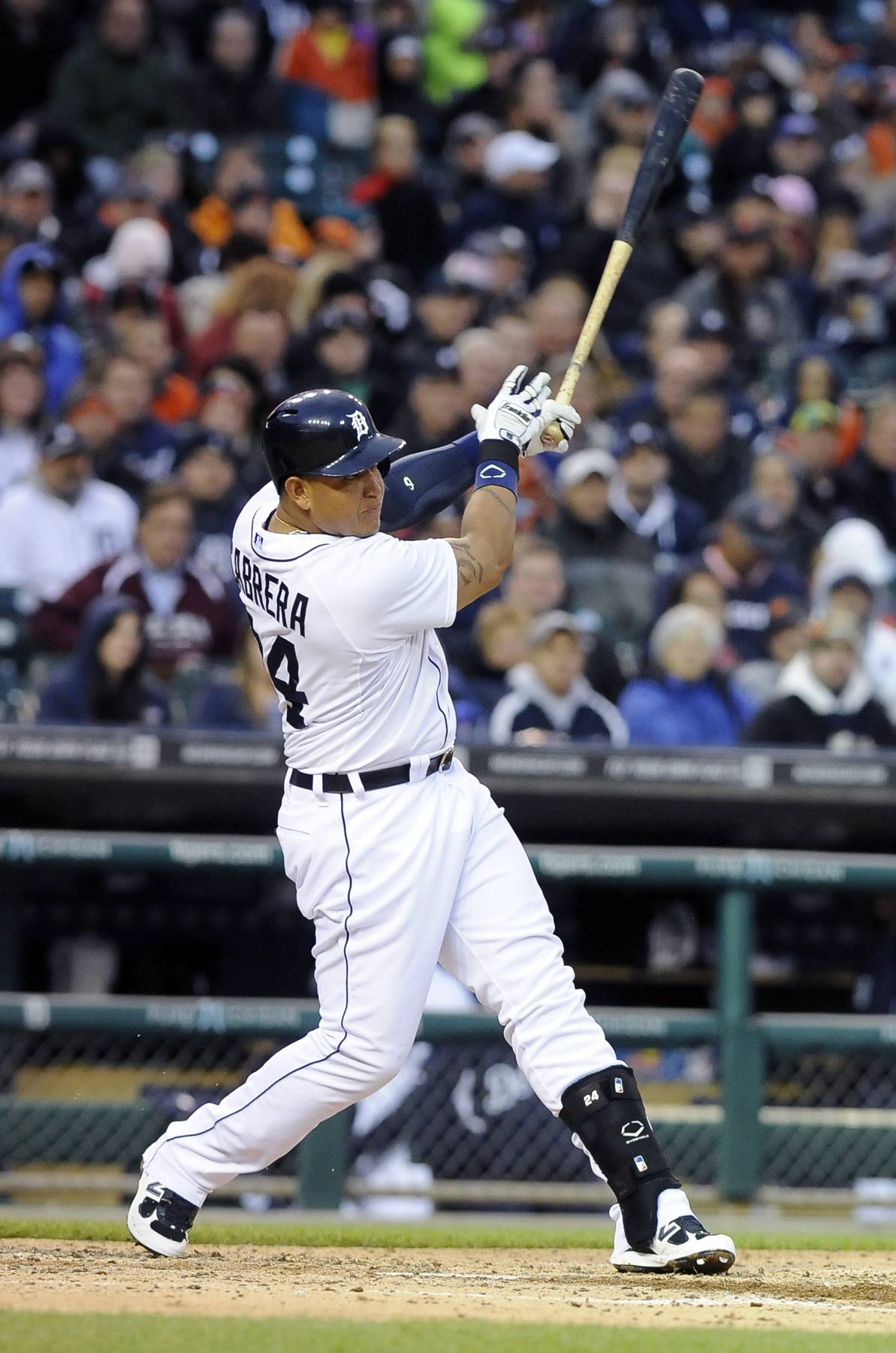 Detroit Tigers' Miguel Cabrera follows through on a two-run home run to right field during the third inning of a baseball game Tuesday against the Chicago White Sox in Detroit.