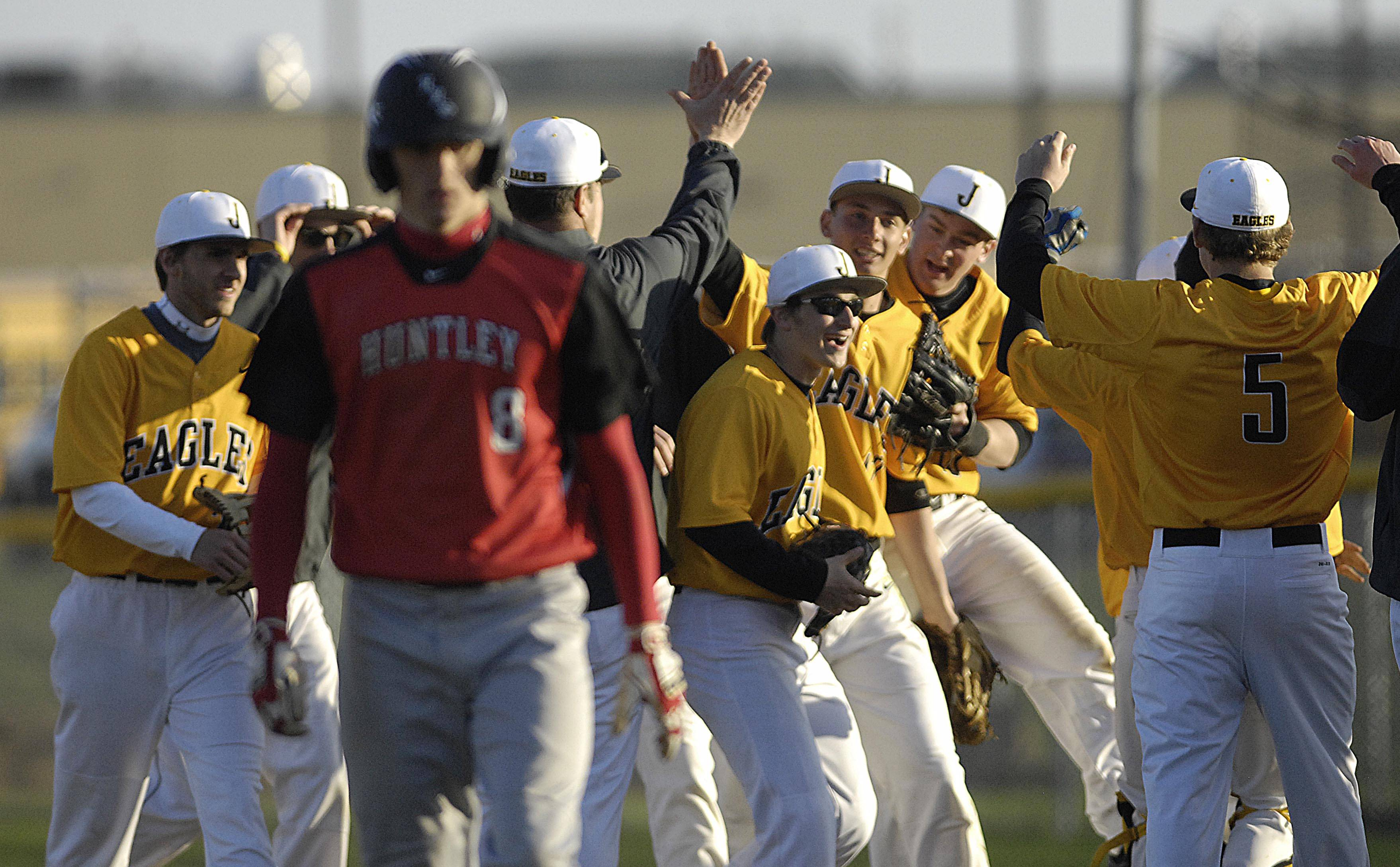 The Jacobs Golden Eagles celebrate their win over Huntley Tuesday in Algonquin.