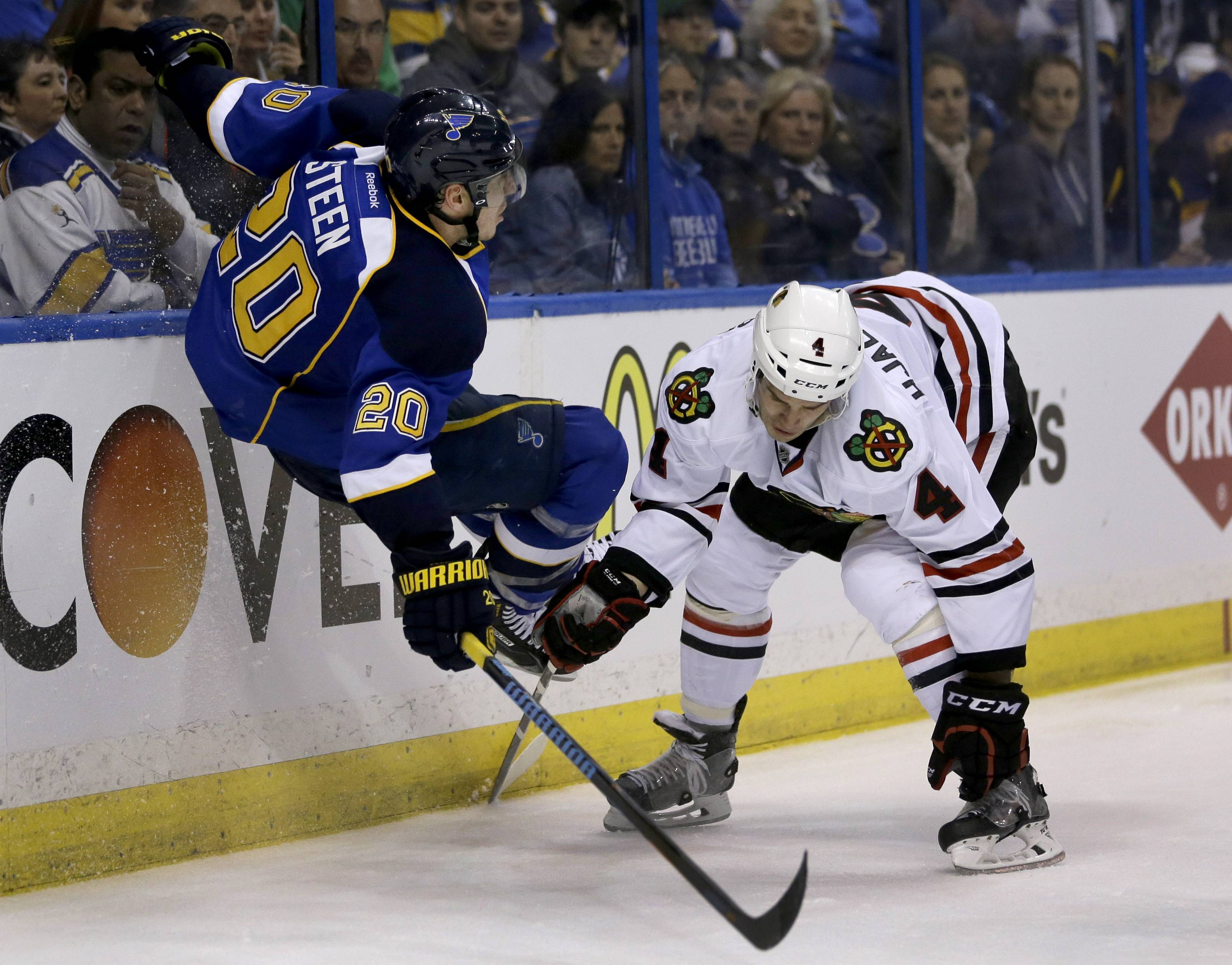 Niklas Hjalmarsson, here delivering a check to the Blues' Alexander Steen during Game 1, has 14 blocked shots in the first three games of the series against St. Louis, second in the NHL.