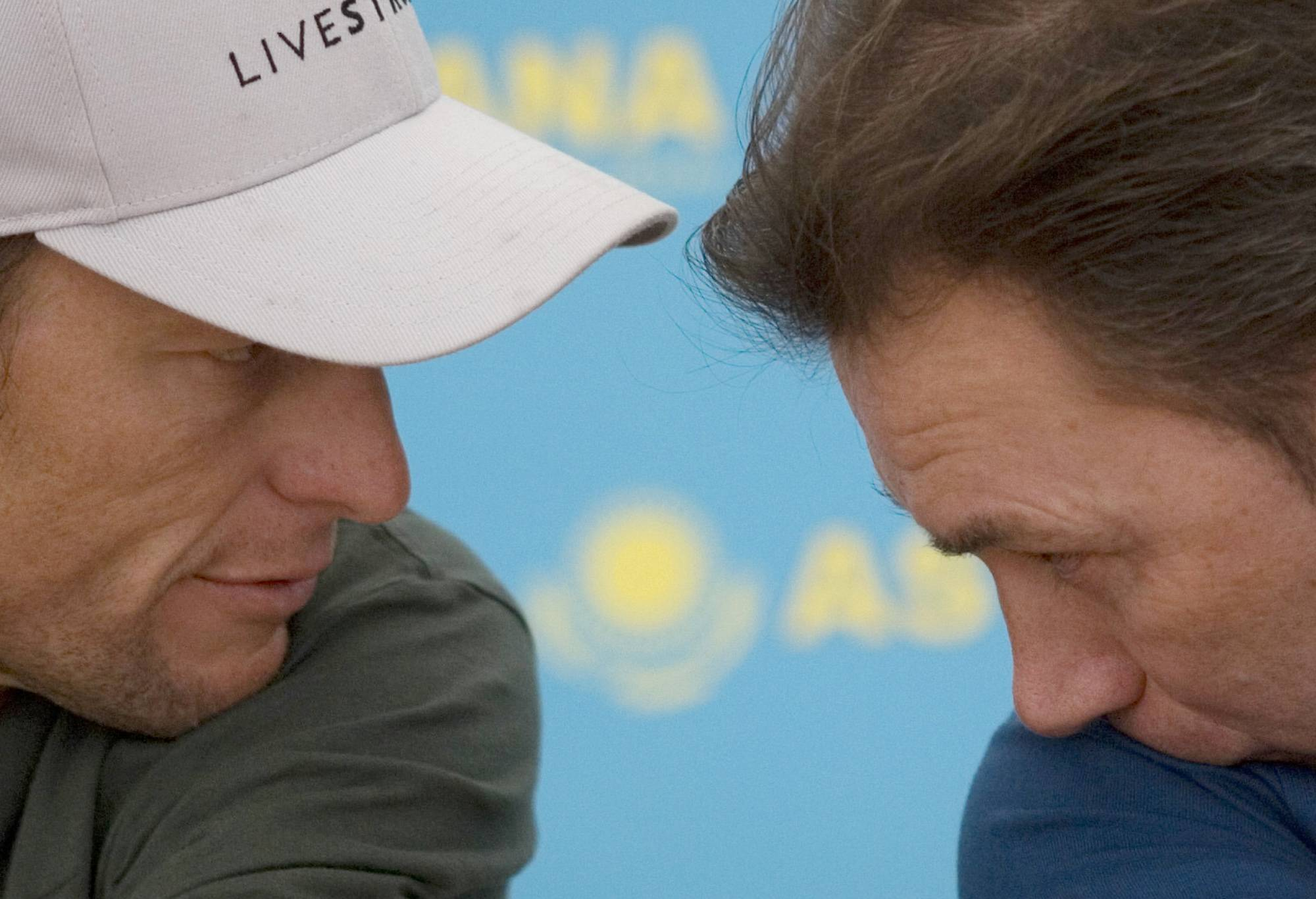 Lance Armstrong's longtime coach Johan Bruyneel, right, was banned for 10 years Tuesday April 22, 2014 for helping organize widespread doping by the former seven-time Tour de France winner's cycling teams.