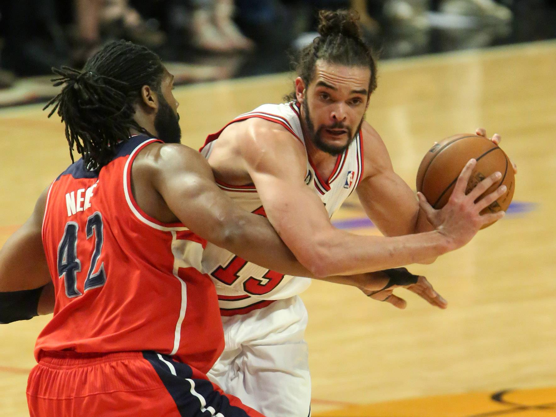 George LeClaire/gleclaire@dailyherald.comThe quiet play of center Joakim Noah hurt the Bulls in Game 1. They'll need more from Noah to counter Wizards forward Nene Hilario, left, and center Martin Gortat in Game 2.