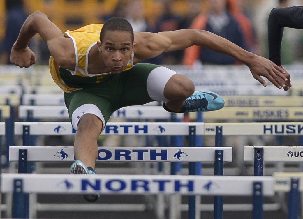 Waubonsie Valley's Jeff Penny competes in the 110-meter hurdles during the Gus Scott Track and Field Invitational at Naperville North on Thursday.