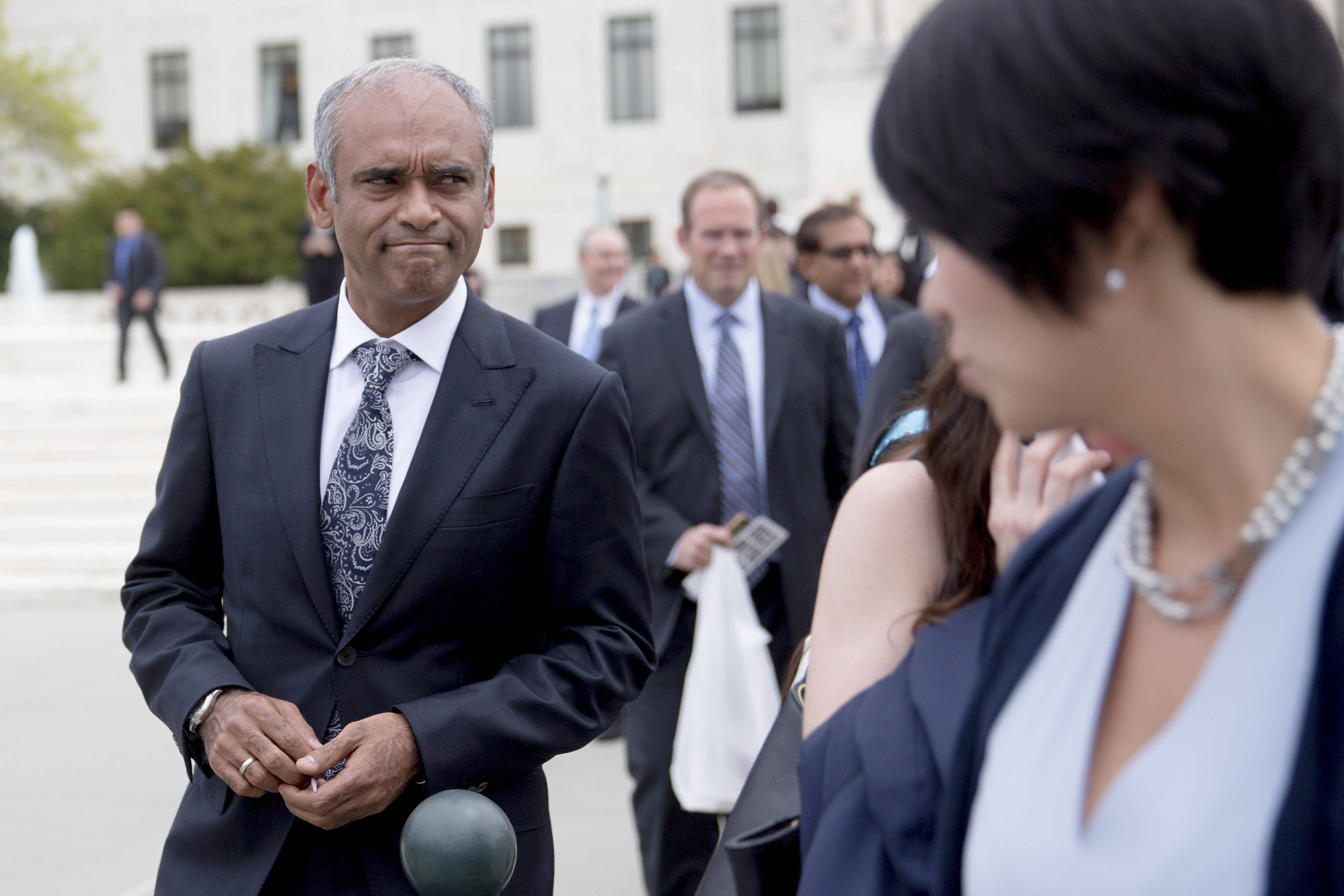 Chet Kanojia, chief executive officer of Aereo Inc., left, leaves the U.S. Supreme Court following oral arguments by Aereo Inc. and American Broadcasting Companies Inc. in Washington Tuesday. Justices questioned the legality of Aereo, the Barry Diller-backed startup aiming to upend the broadcast industry's decades-old business model by selling live television programming over the Internet.