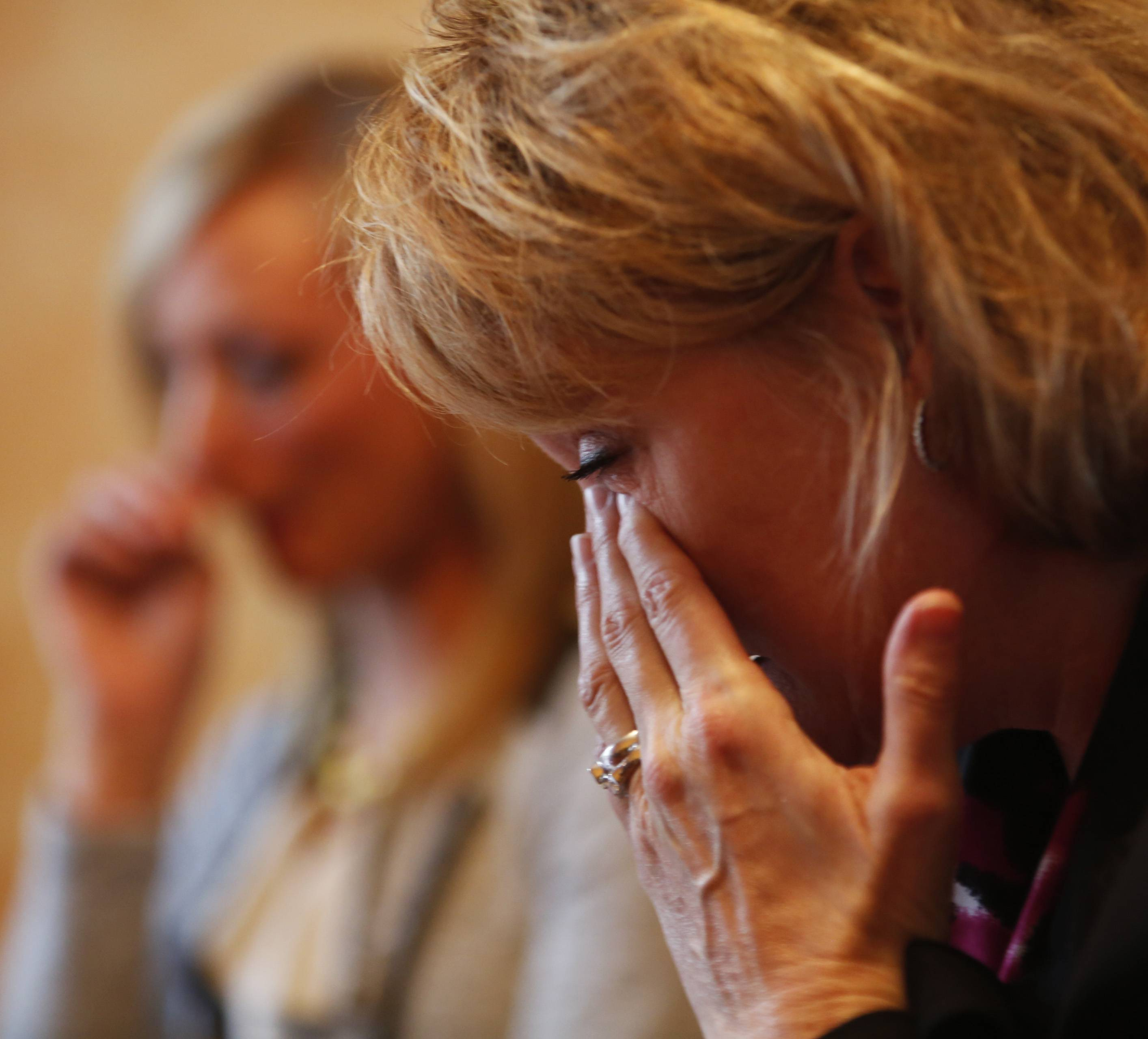 Esther Martin wipes tears from her eyes as she listens to her daughter, Brooke, describe the ways in which Esther was able to support her struggle with an eating disorder.