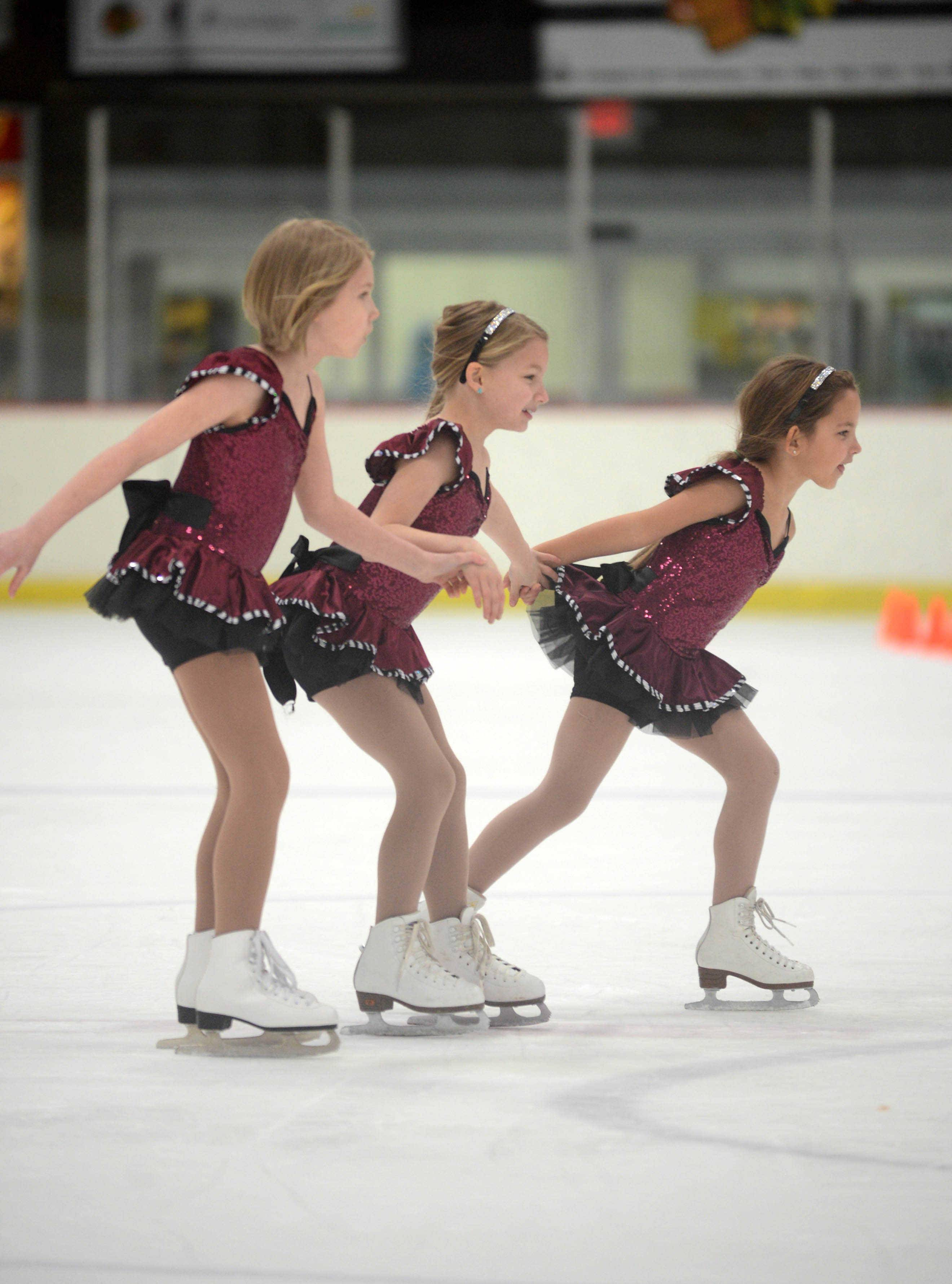 ON THE COVER: From left, Alpha I-level students Anna Wojnicki, 9, of Mount Prospect, Lena Heather, 8, of Chicago, and Ava Melnick-Karas, 8, of Morton Grove participate during rehearsal at the Oakton Ice Arena for the upcoming Oakton Ice Show.