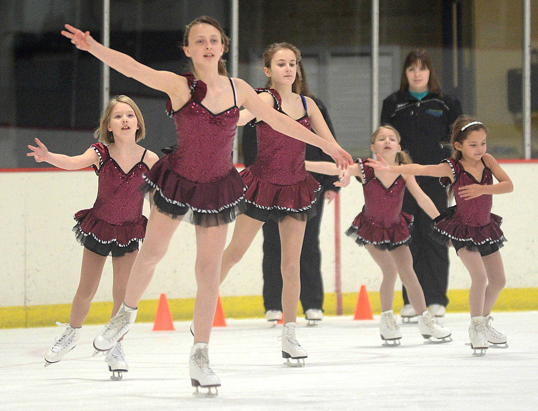 Faye Kolasinski, center, 12, of Chicago leads her Alpha I-level classmates onto the ice for rehearsal at the Oakton Ice Arena for the upcoming Park Ridge Park District Ice Show.