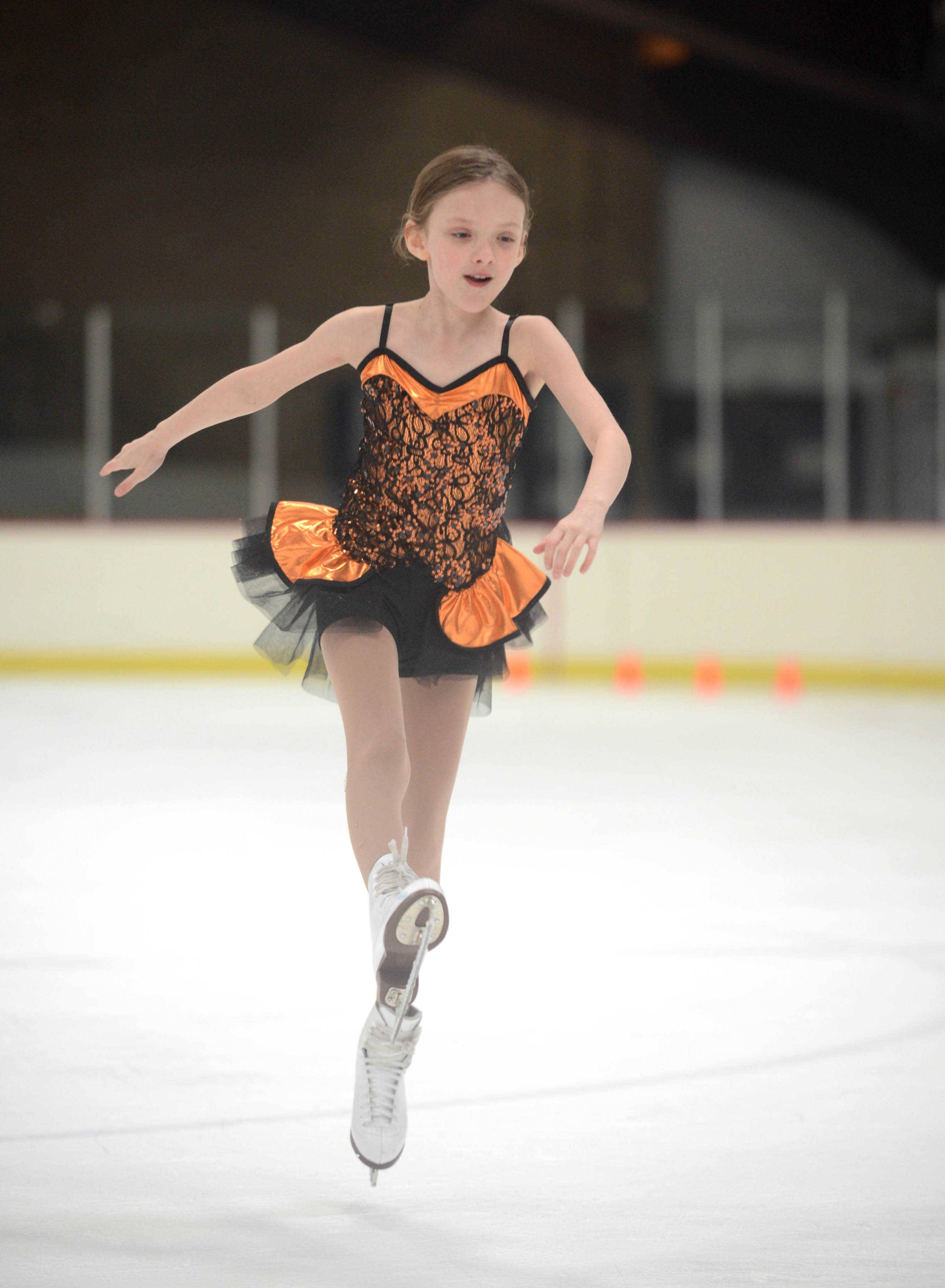 Trinity Kueppers, 8, of Park Ridge participates with Gamma-level classmates during rehearsal at the Oakton Ice Arena for the upcoming Park Ridge Park District Ice Show.
