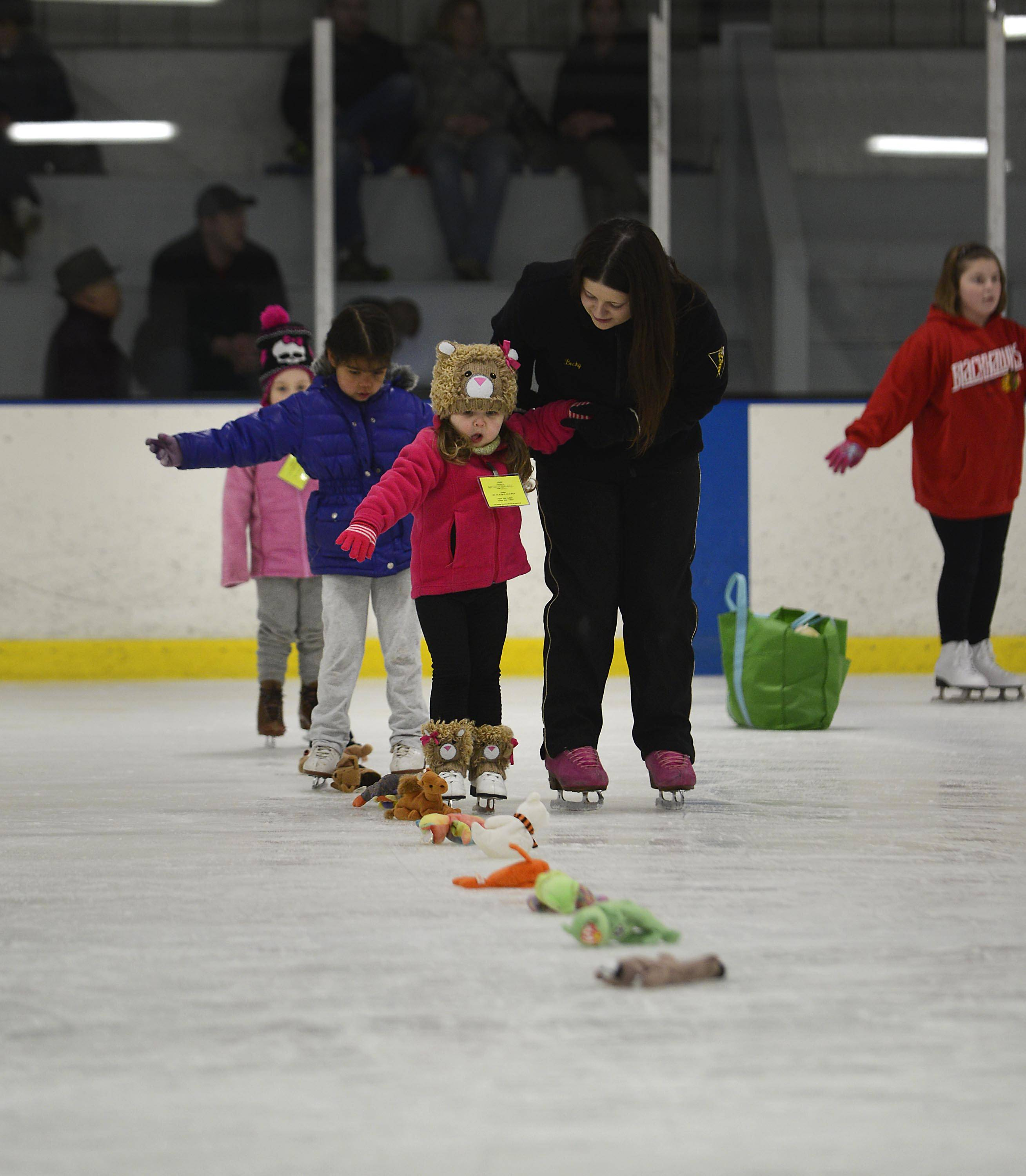 Samantha Kay of Cary takes the lead in the Snowplow Sam beginners class for 4- and 5-year-olds at the Crystal Ice House.