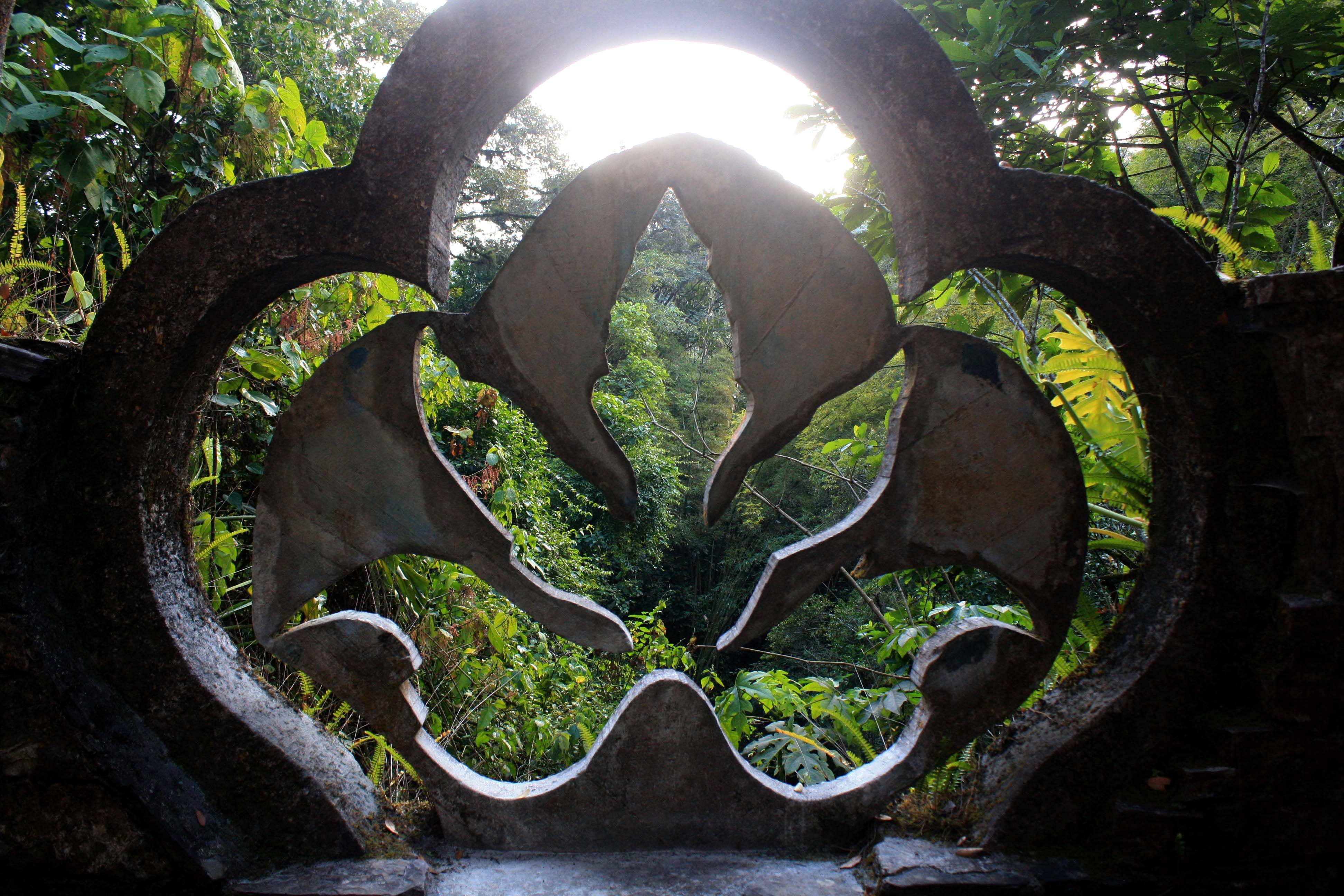 Trees are framed through a concrete philodendron sculpture at Las Pozas, which is located on a 100-acre hillside where the Sierra Madre mountains and coastal plains of the northeast state of San Luis Potosi meet in Mexico.