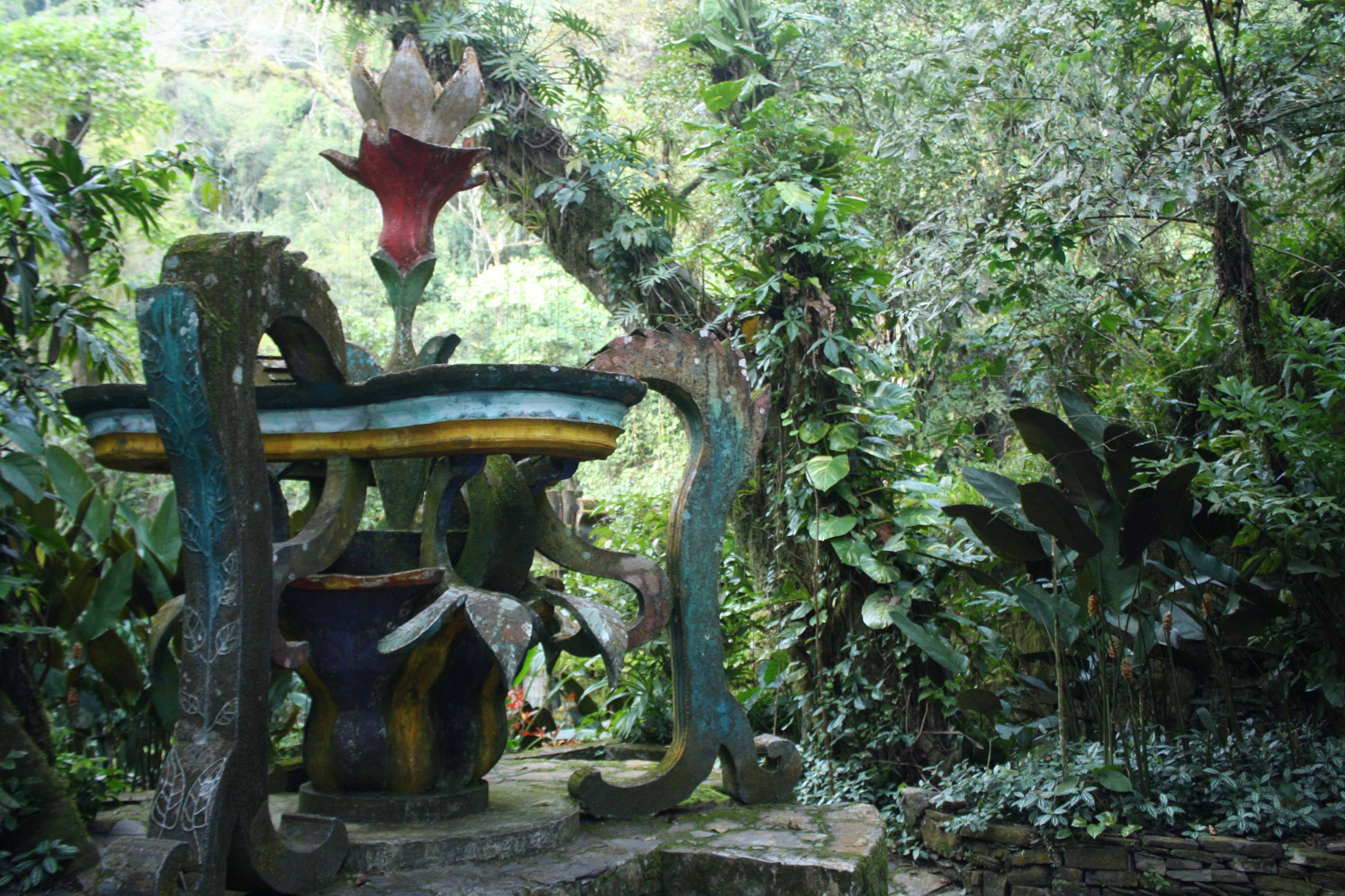 A flower sculpture in Las Pozas evokes the ruins of ancient Greece but is overrun by exotic plants.
