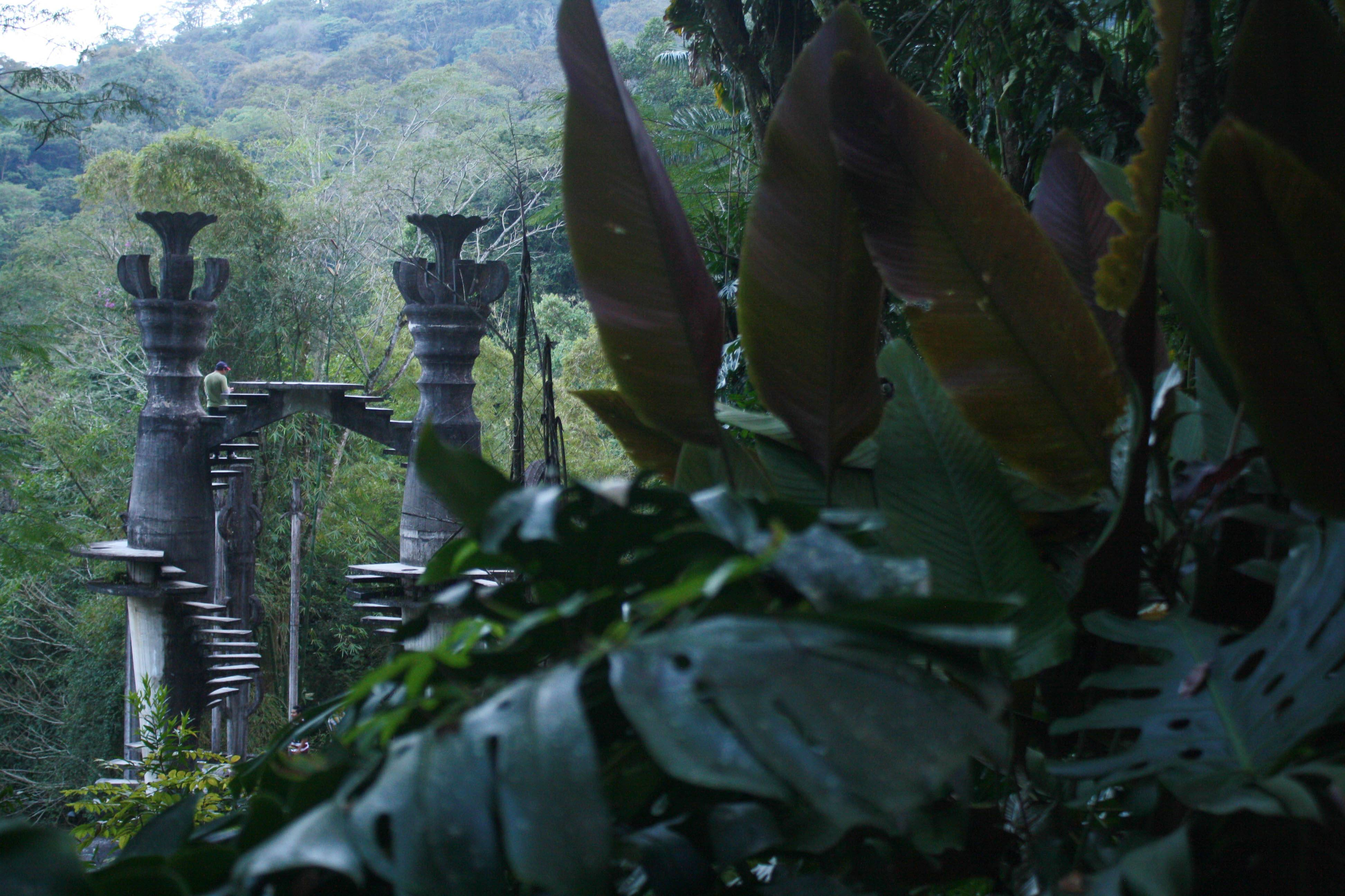 Two spiral staircases lead nowhere amid an ornate concrete structure in Las Pozas.