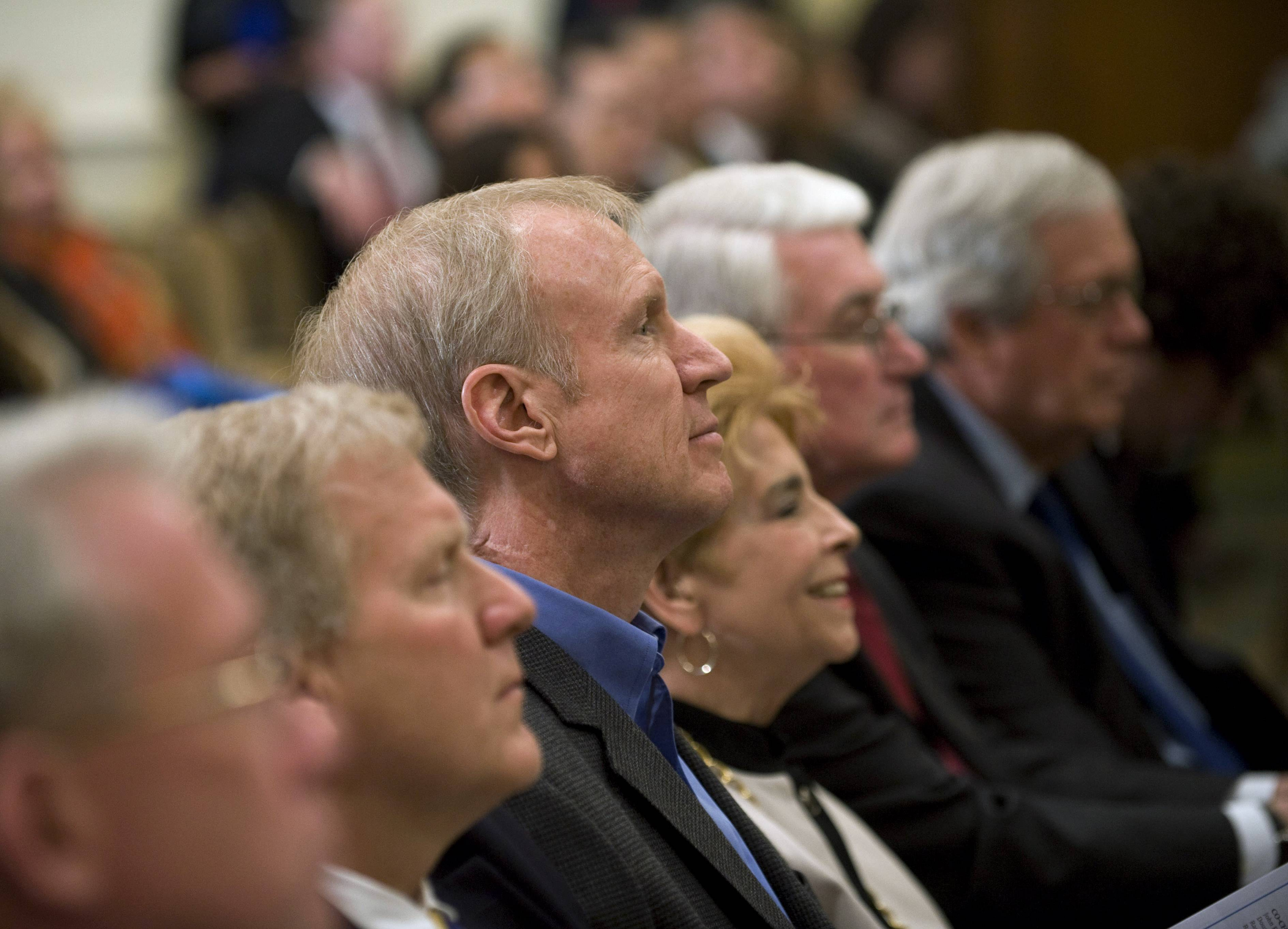 Illinois Republican gubernatorial candidate Bruce Rauner, center, listens to speakers at the Illinois Business Immigration Coalition meeting on Tuesday. Rauner and other top Illinois Republicans who support immigration reform legislation that's stalled in Washington attended the event in Chicago.