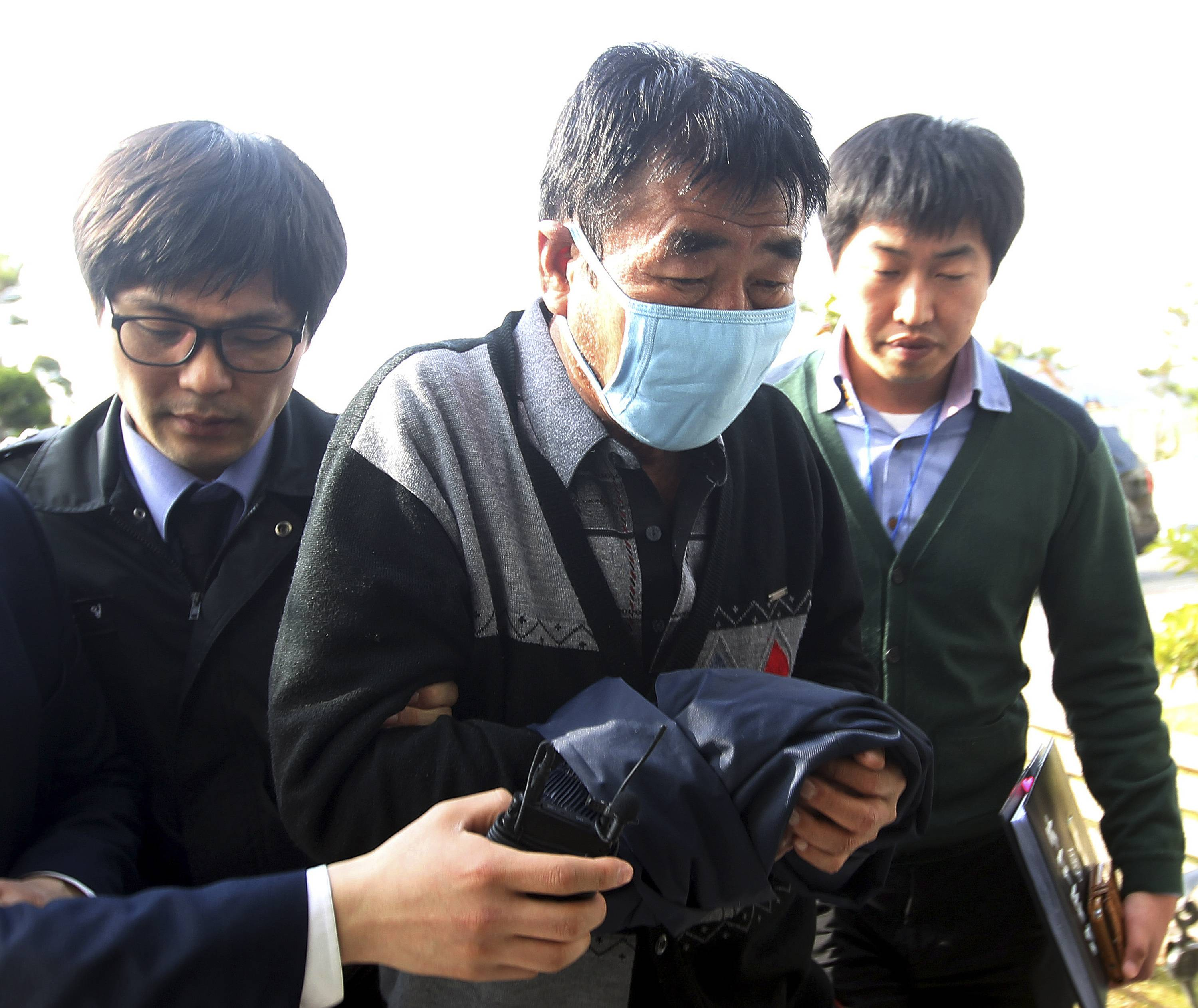 Lee Joon-seok, center, the captain of the sunken ferryboat Sewol, and two crew members have been arrested, accused of negligence and abandoning people in need. Six other crew members have been detained -- two of them on Tuesday -- though prosecutors have yet to obtain arrest warrants for them.