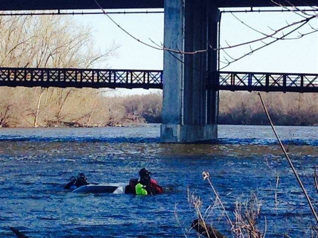 Divers were in the Fox River in Elgin near Interstate 90 after it was reported Tuesday morning that a vehicle was in the water.