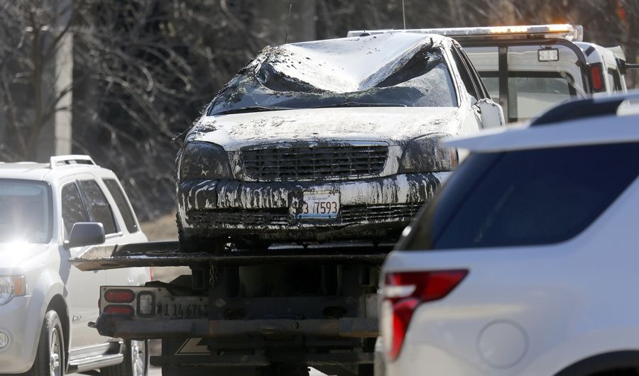 A vehicle pulled from the Fox River in Elgin was towed away Tuesday morning.