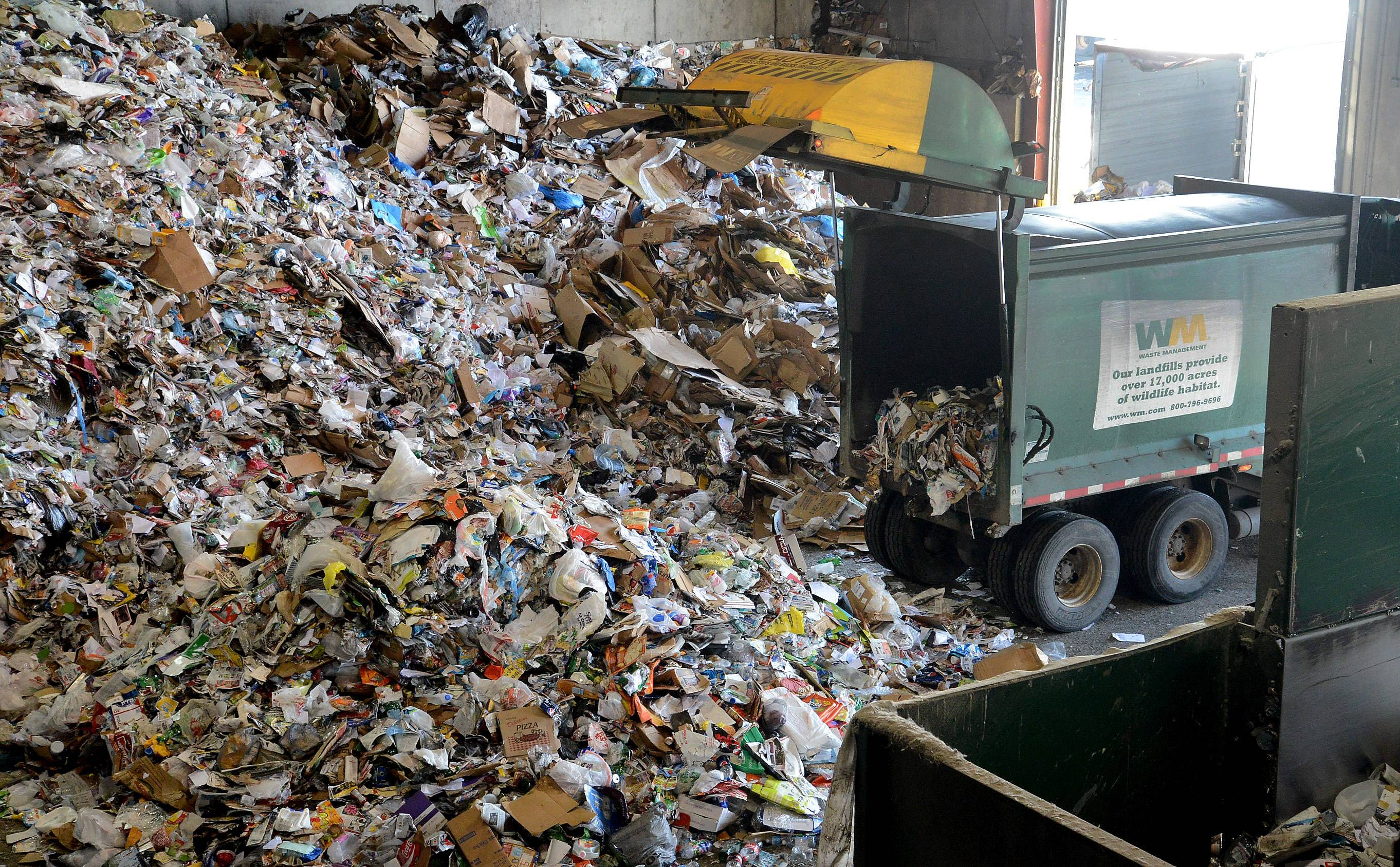 Waste Management's recycling center in Grayslake, where about 12 percent of what workers will sift through is not recyclable. A single-digit figure would be ideal, experts say.