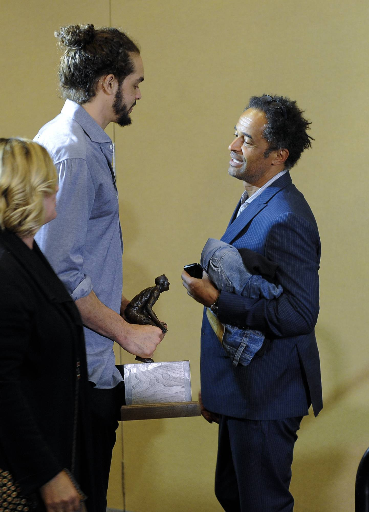 After receiving the NBA defensive player of the year award Monday, the Bulls' Joakim Noah, left, talks with his father -- tennis star Yannick Noah.