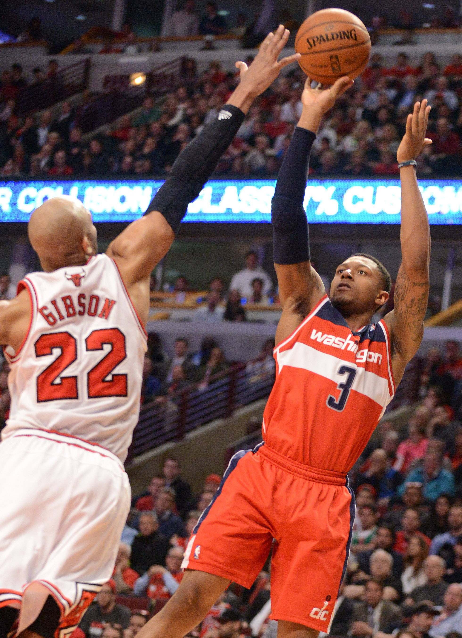 Washington Wizards guard Bradley Beal (3) scores 2 of his 26 points with a jumper over Chicago Bulls forward Taj Gibson (22).