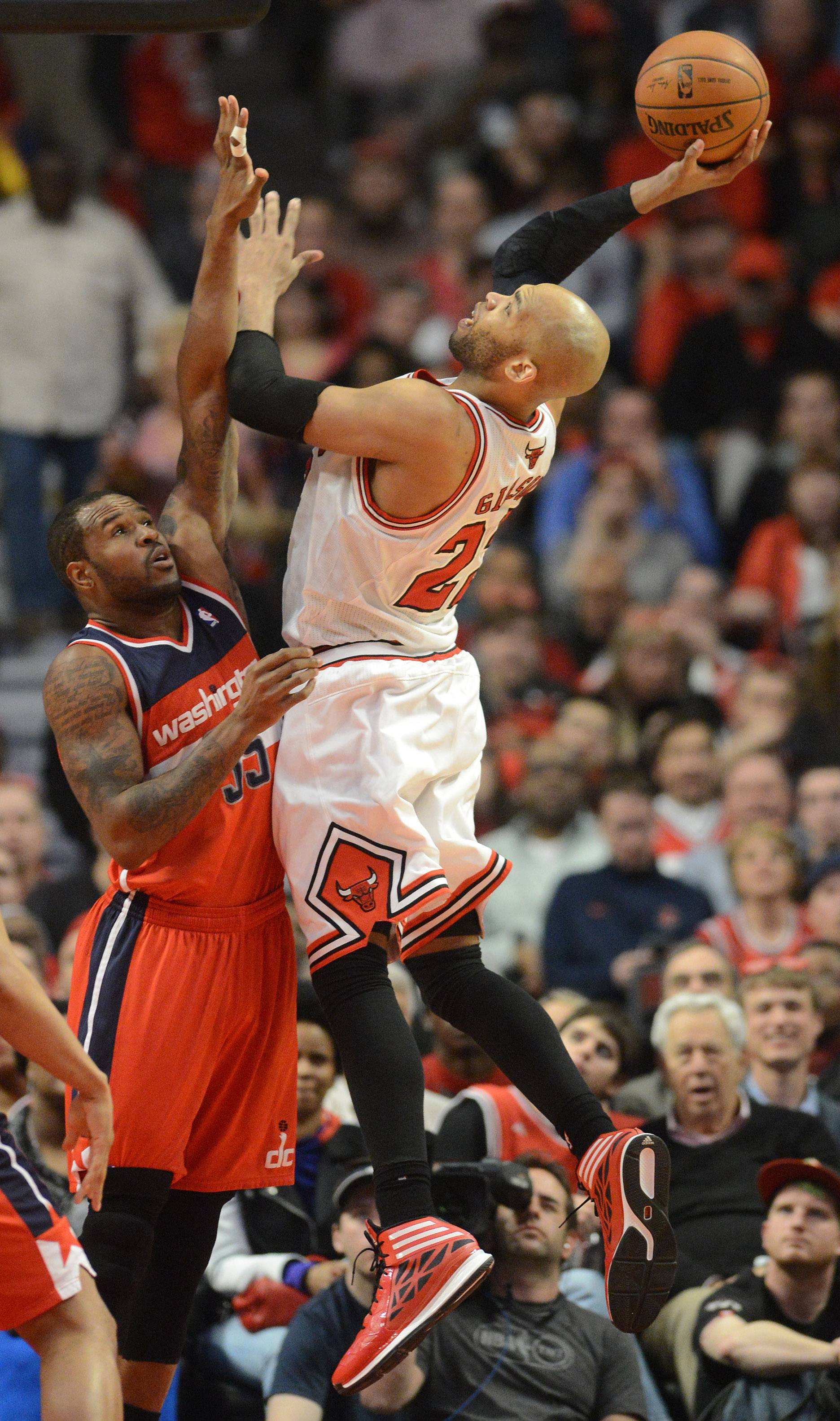 Chicago Bulls forward Taj Gibson (22) gets up a shot over Washington Wizards forward Trevor Booker (35).