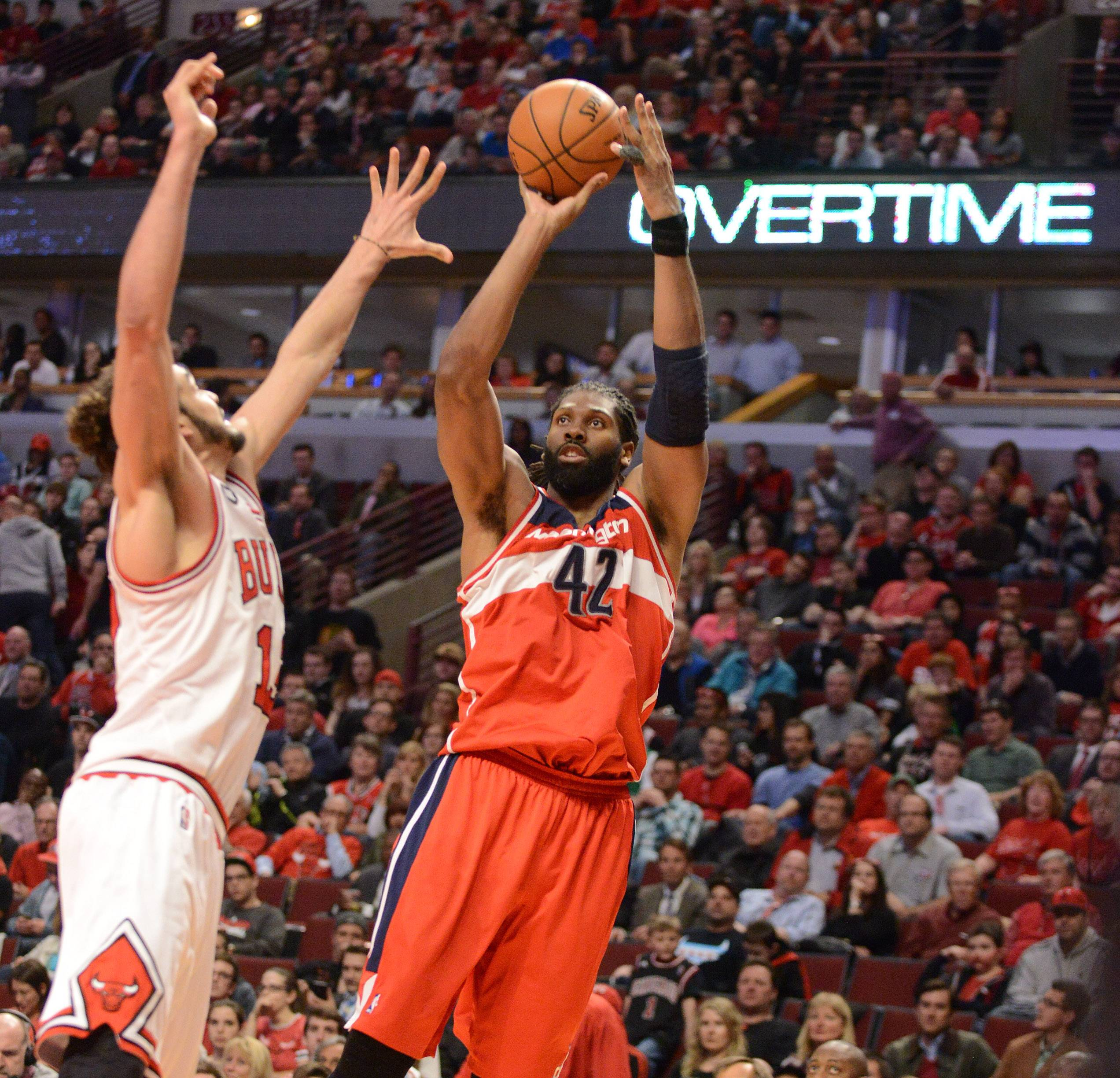 Washington Wizards forward Nene (42) scores over Chicago Bulls center Joakim Noah (13) in overtime.